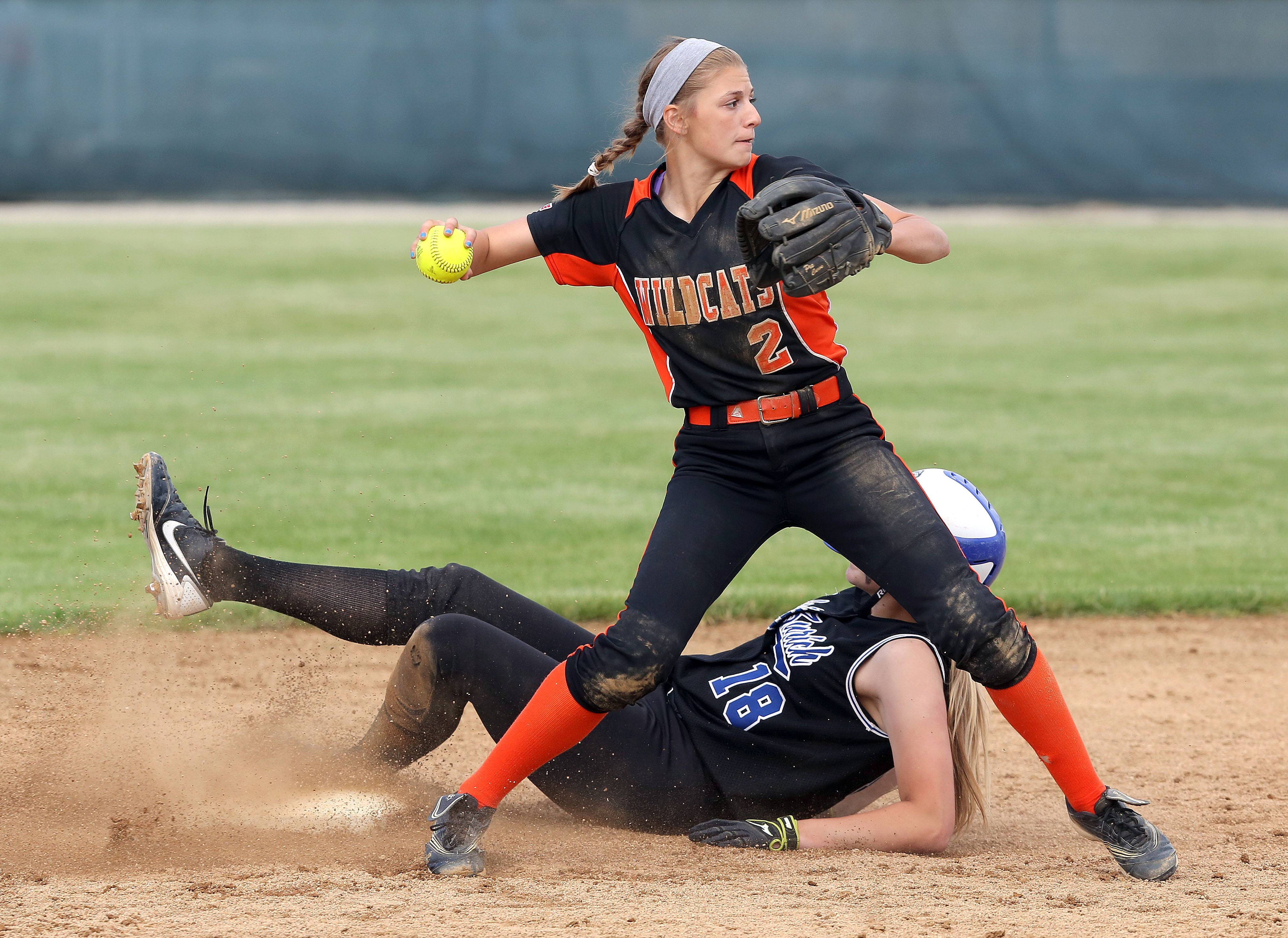 Lake Zurich's Sarah Schnecker is out at second base as Libertyville's Jessie Lauret tries to turn a double play in sectional semifinal play Wednesday at Stevenson.