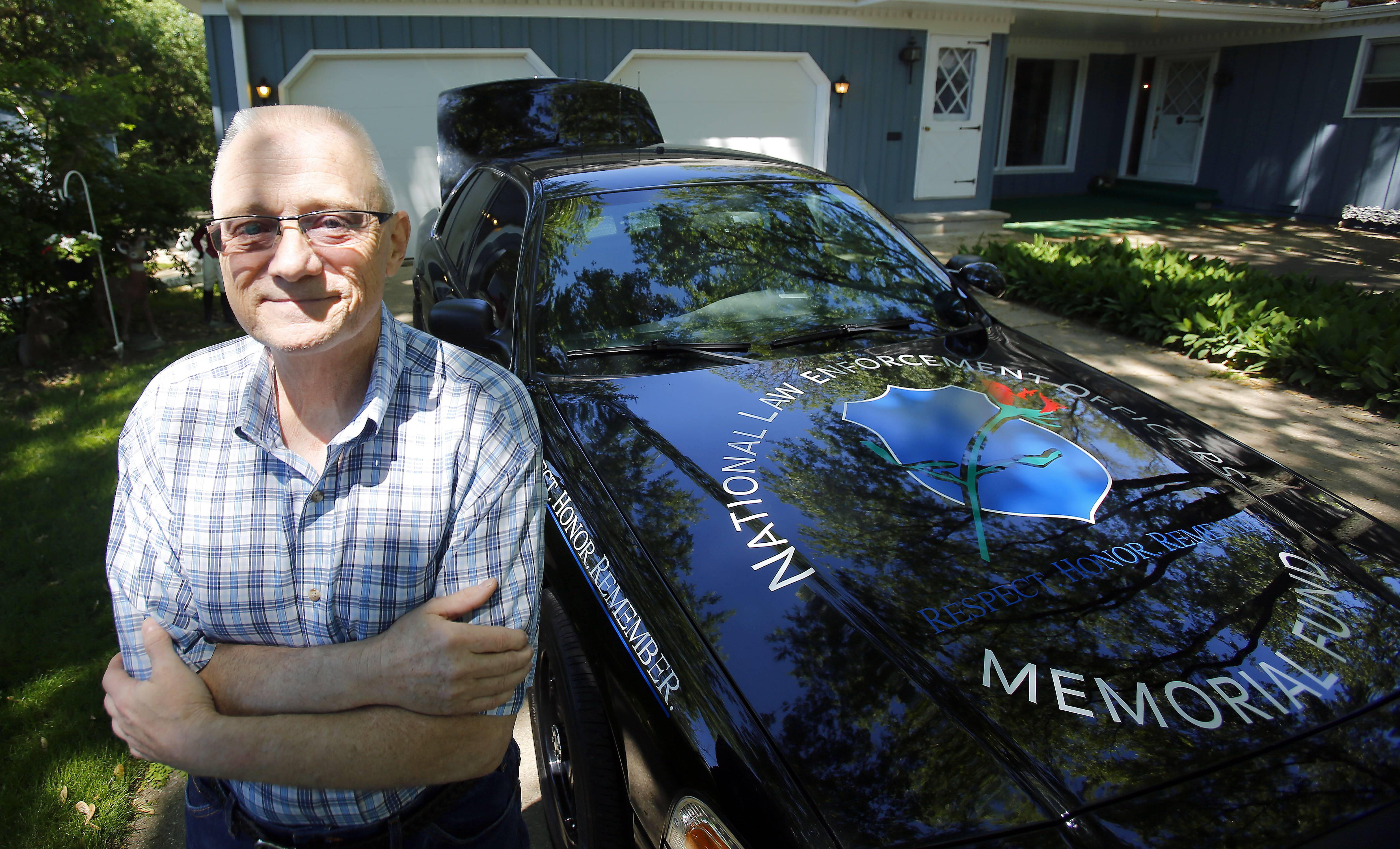 Cancer survivor Keith Kmieciak of South Elgin built a police memorial car in order to get his mind off his cancer treatment last year.