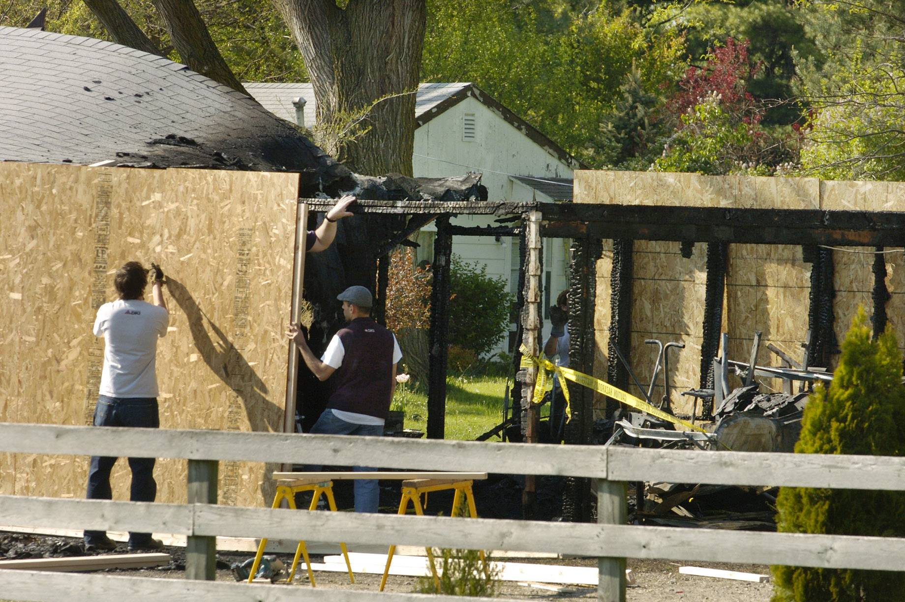 "Workers boarded up the Long Grove garage where jockey Eusebio ""Eddie"" Razo Jr. died in a fire April 24, 2012. The cause of Razo's death and the blaze remain undetermined."