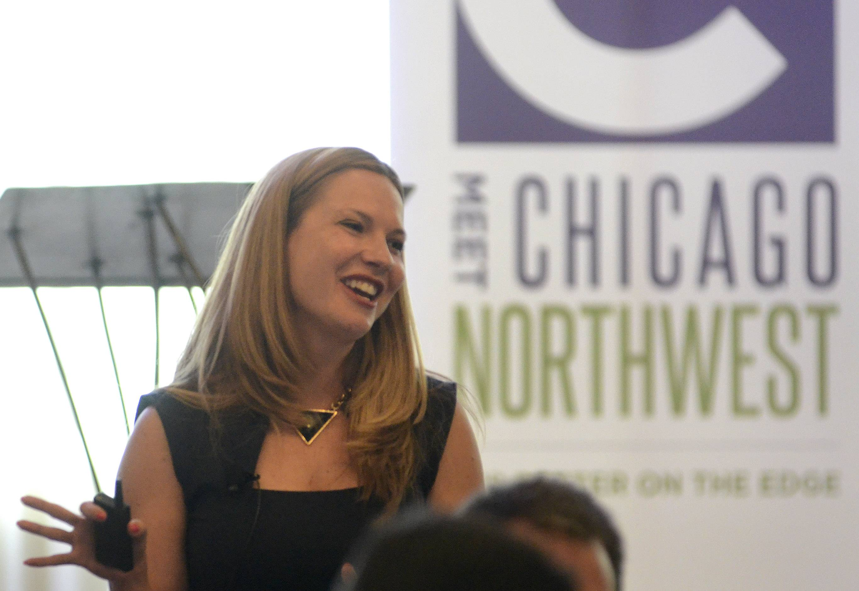 Guest presenter Jen Hoelzle, deputy director of the Illinois Office of Tourism, discusses the state's efforts to attract visitors during the annual luncheon of Meet Chicago Northwest in Elk Grove Village Wednesday.
