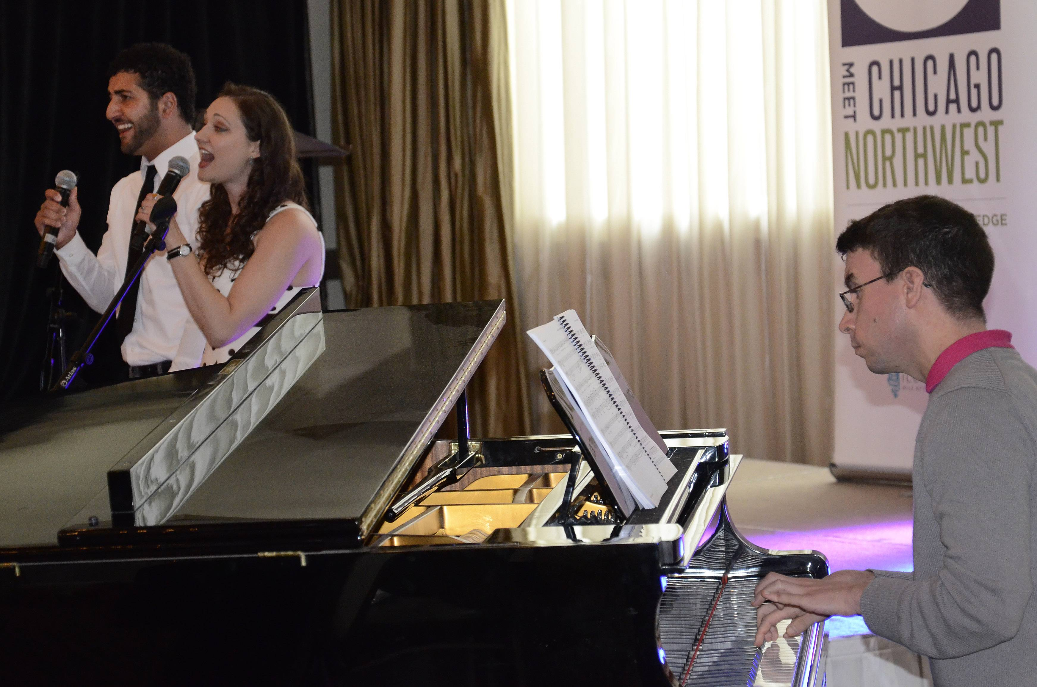 "From left, Tommy Malouf, Monica Szaflik and Mike Evans of Metropolis Performing Arts Centre in Arlington Heights perform a piece from ""The Last Five Years,"" on Wednesday during the annual luncheon of Meet Chicago Northwest at Belvedere Events & Banquets in Elk Grove Village."