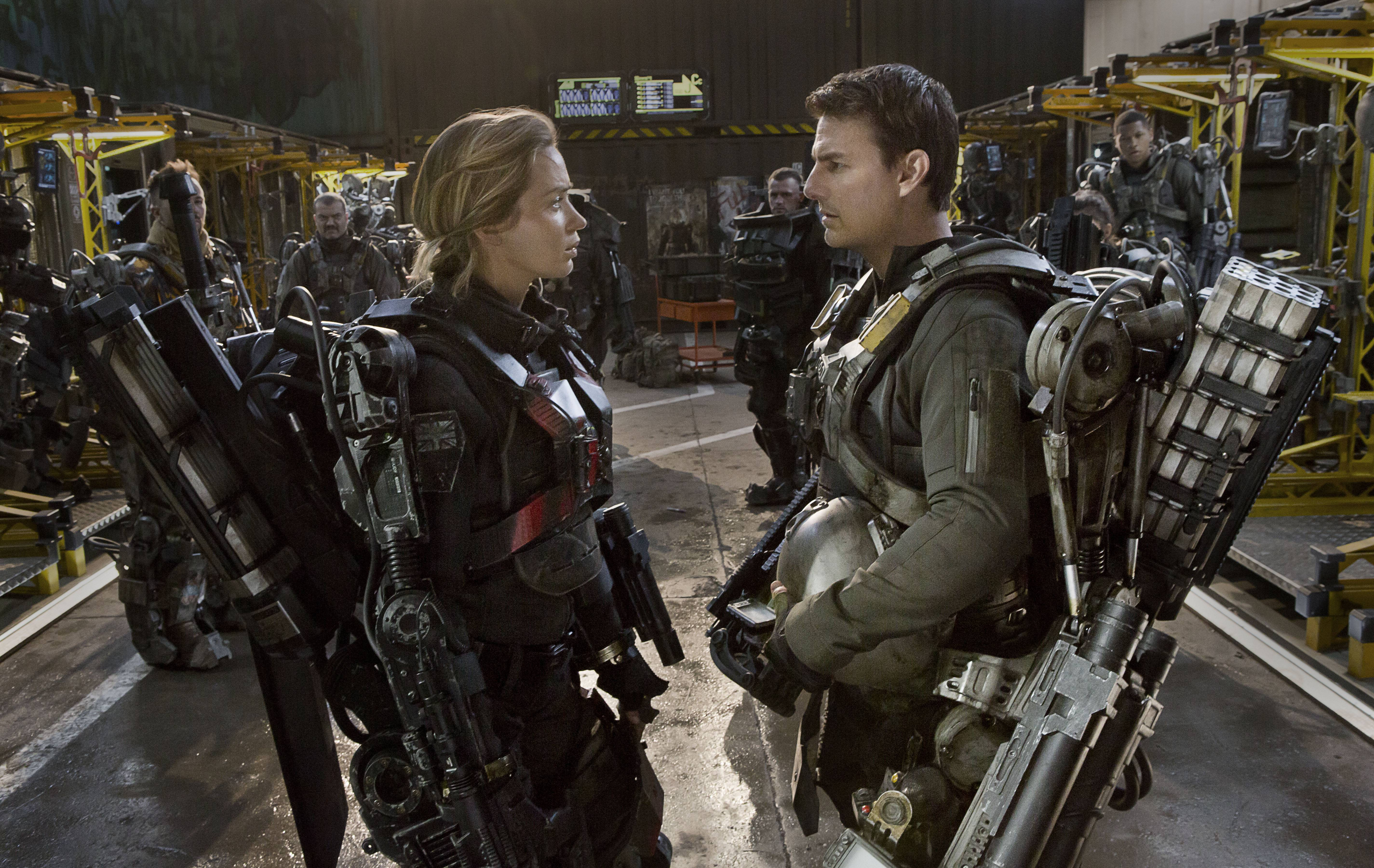 "Experienced fighter Rita (Emily Blunt) teaches William Cage (Tom Cruise) how to better battle alien enemies in the time-shifting thriller ""Edge of Tomorrow."""