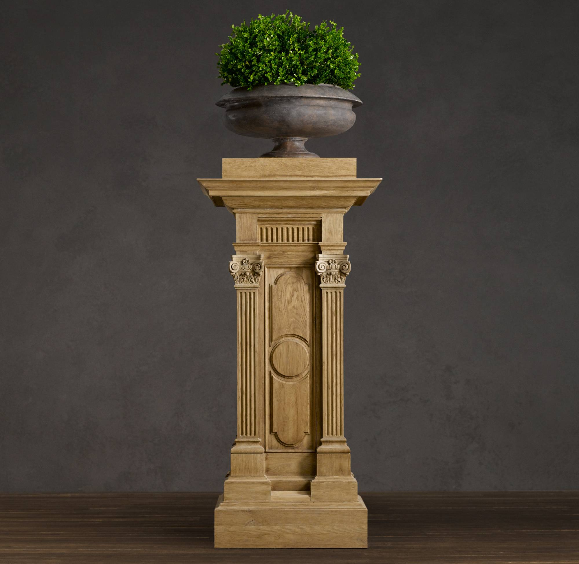 This carved oak plinth makes a statement, and can be used to hold artwork, plants or as a side table.