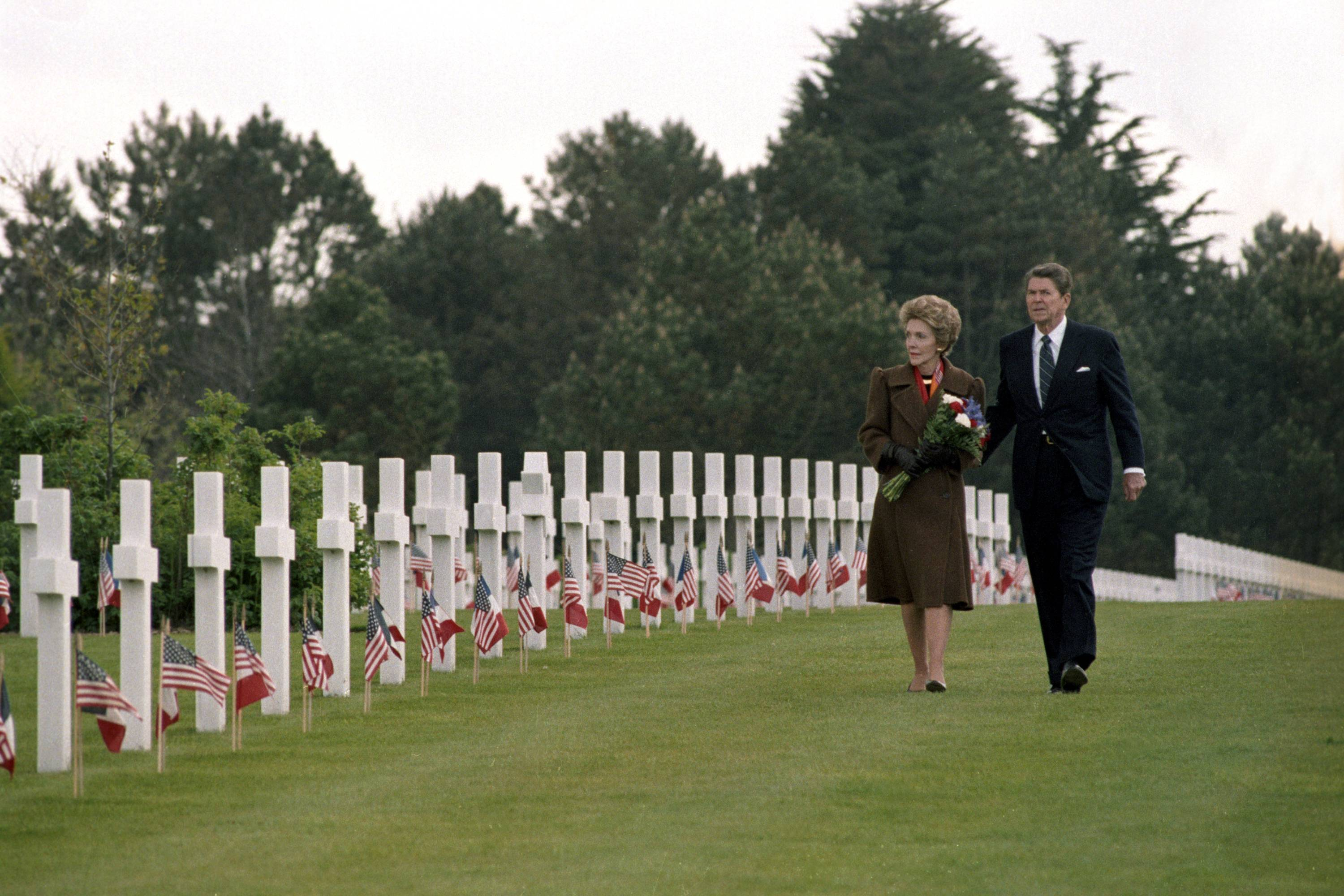 President Ronald Reagan and first lady Nancy Reagan walk among the graves at Normandy American Cemetery and Memorial on June 6, 1984. Attending a D-Day anniversary observance in Normandy wasn't always a presidential tradition. Ronald Reagan was the first, delivering an evocative and emotional remembrance on the 40th anniversary in 1984.