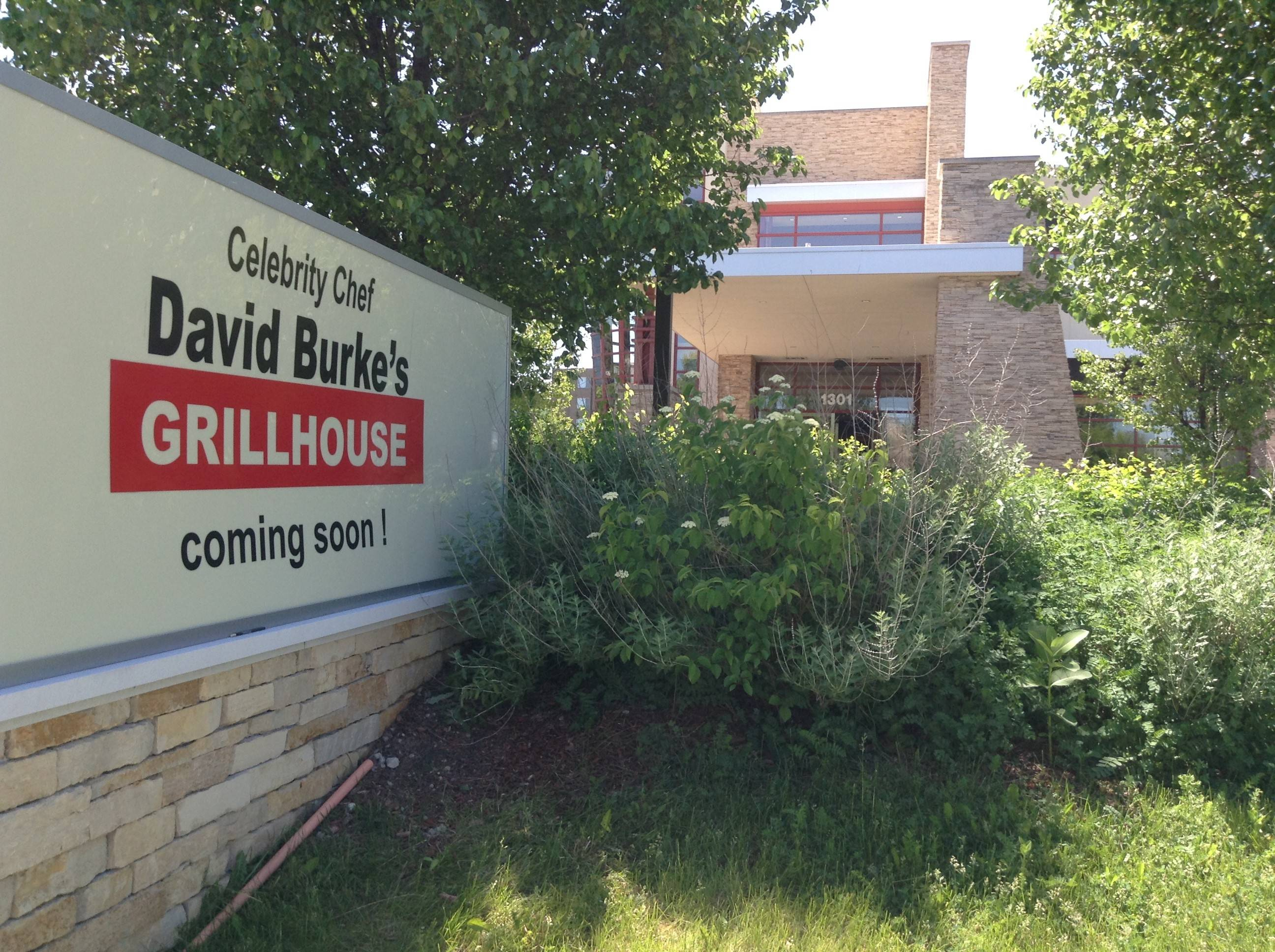 A new sign proclaims the imminent arrival of David Burke's Grillhouse at 1301 American Lane in Schaumburg, where Entourage restaurant closed four years ago.