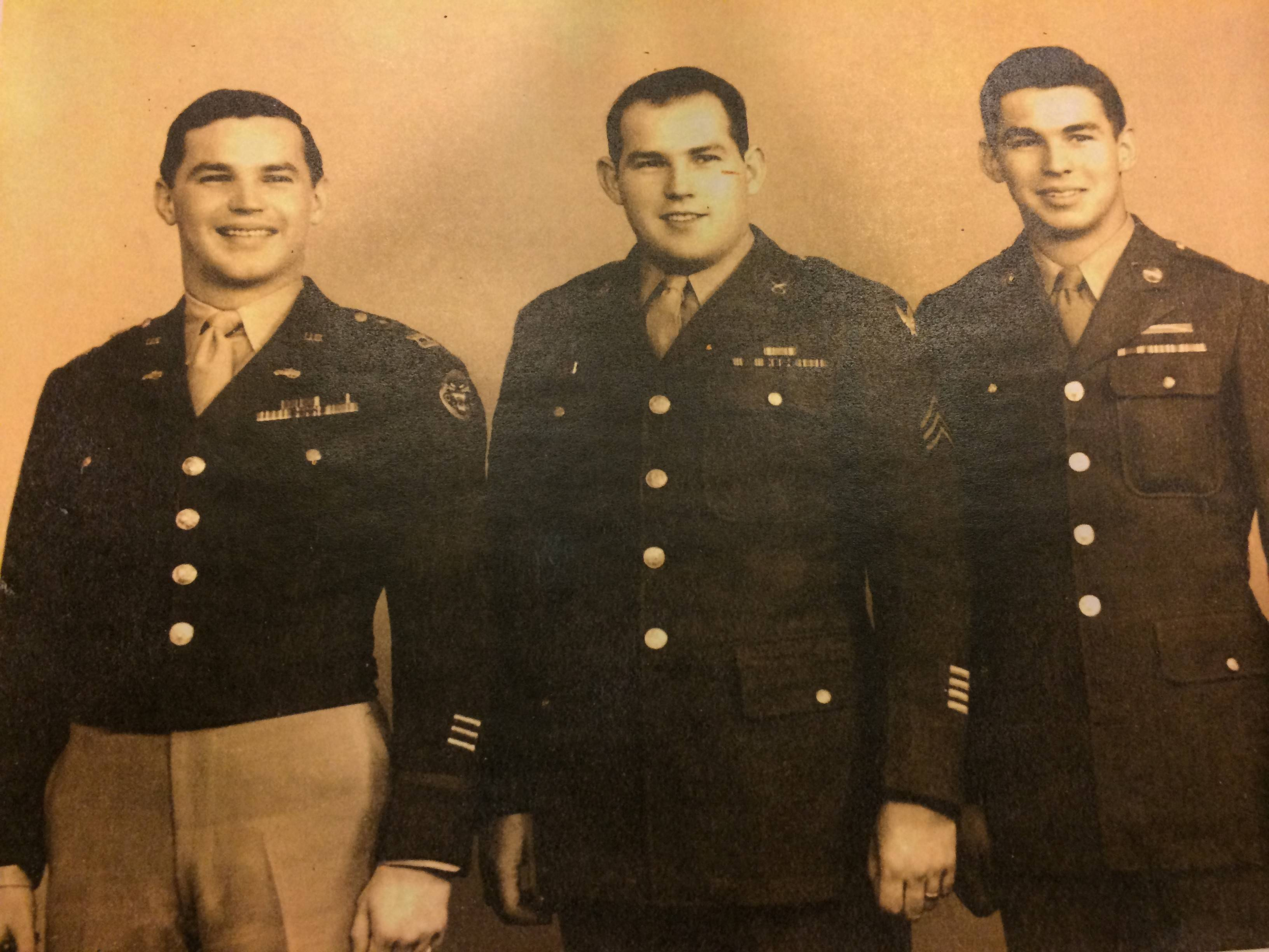 From left, Richard Duchossois with his brothers George and Albert during World War II.