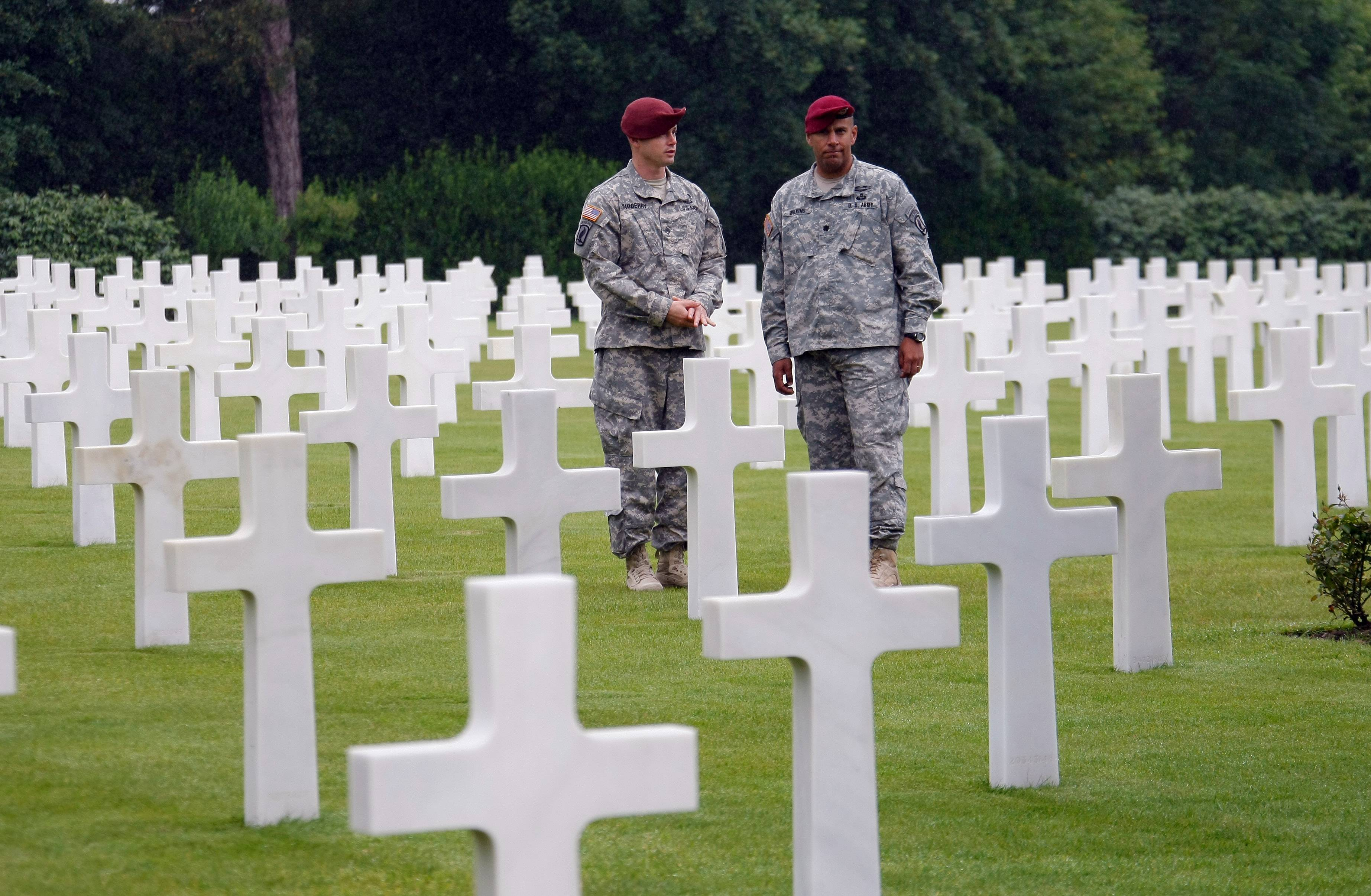 LTC Patrick Wilkins, right, 42, and Sergeant Major Stephen Yarberry of 173rd Airborne Brigade walk in the Normandy American Cemetery and Memorial, in Colleville sur Mer, France. World leaders and veterans are marking the 70th anniversary of the invasion this week in Normandy.