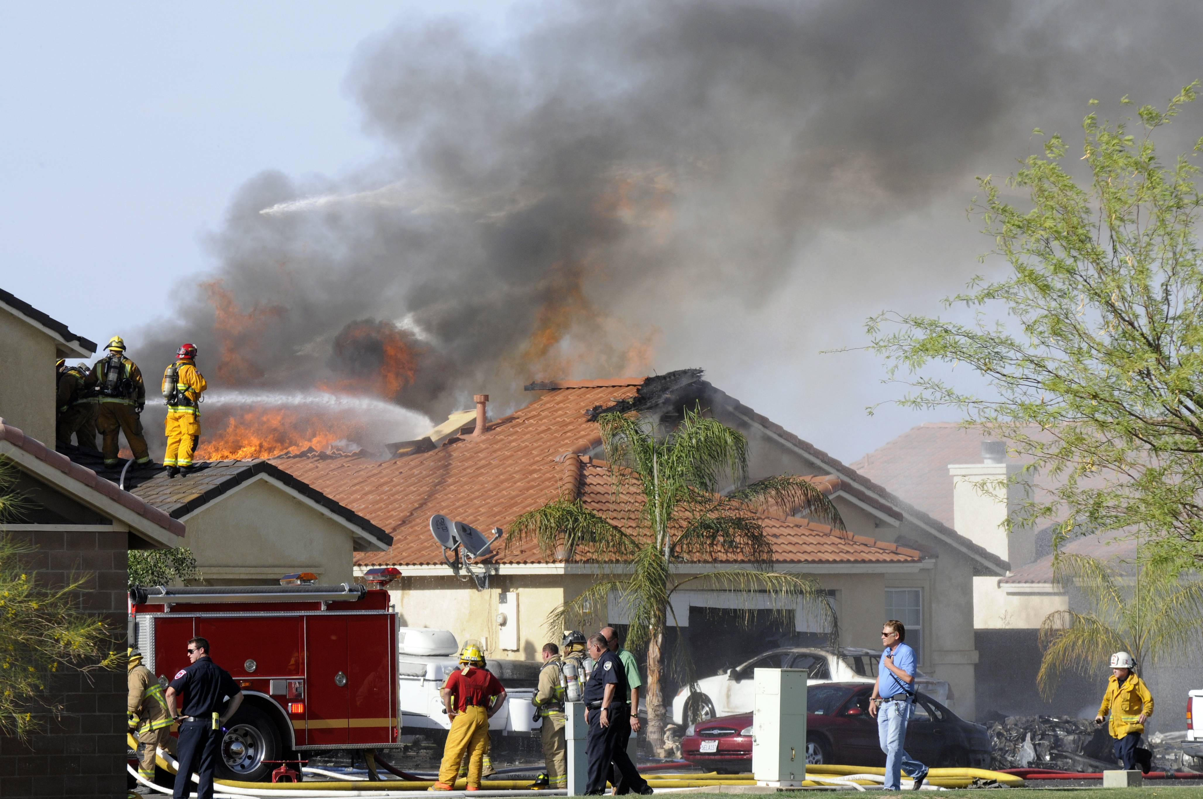 A military jet crashed on a residential street in the desert community of Imperial, Calif., setting two homes on fire Wednesday, June 4, 2014. The jet was a Harrier from Marine Corps Air Station in Yuma, Arizona.