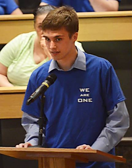 Elgin Community College student Clay Bahl congratulates the board on their decision to keep the custodial staff.