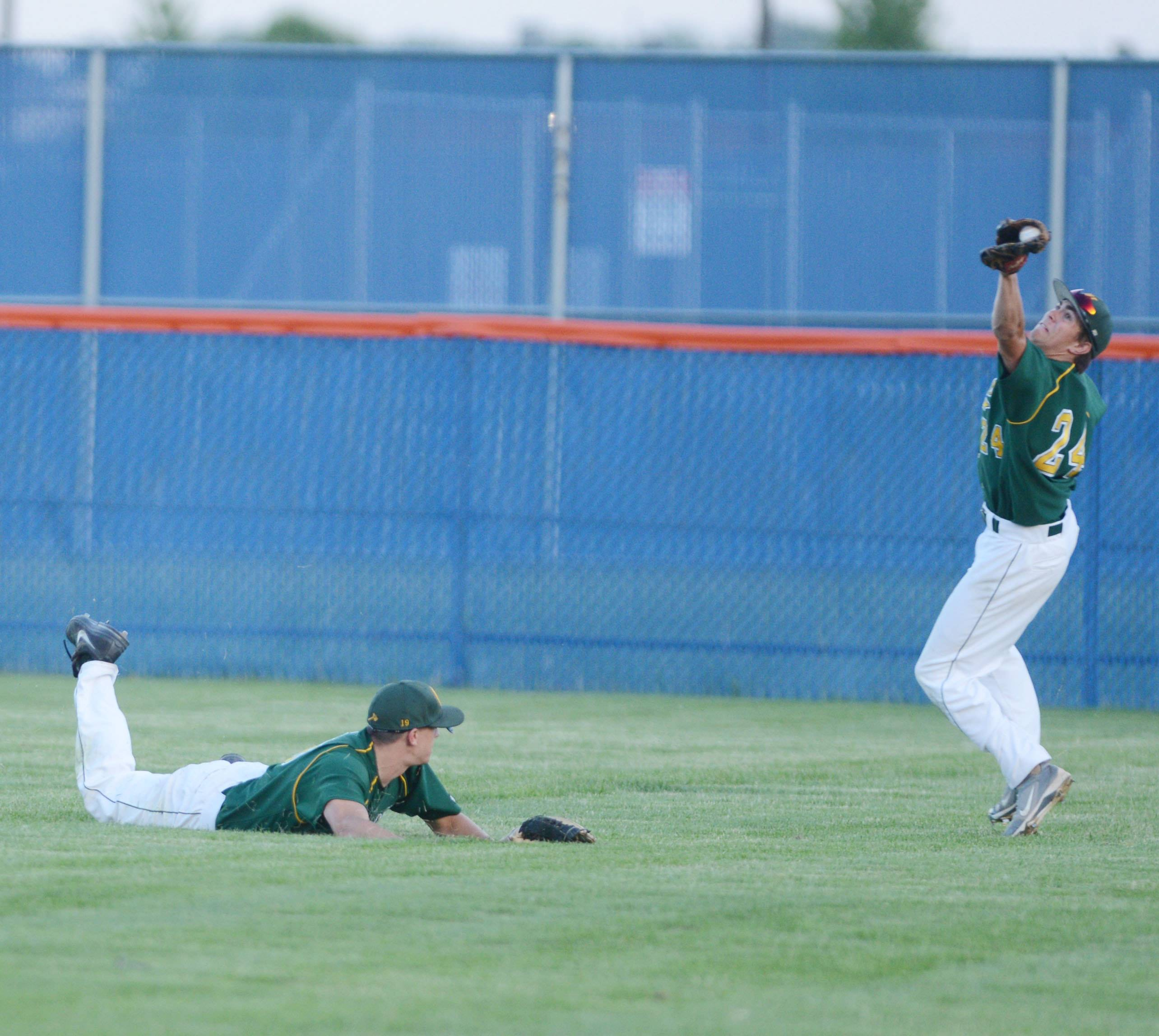 #18 Jack Eddy,left, and #24 Ryan Strick of Waubonsie dive for the ball during the Waubonsie Valley vs. Downers Grove South at Class 4A Oswego baseball sectional semifinal Thursday.