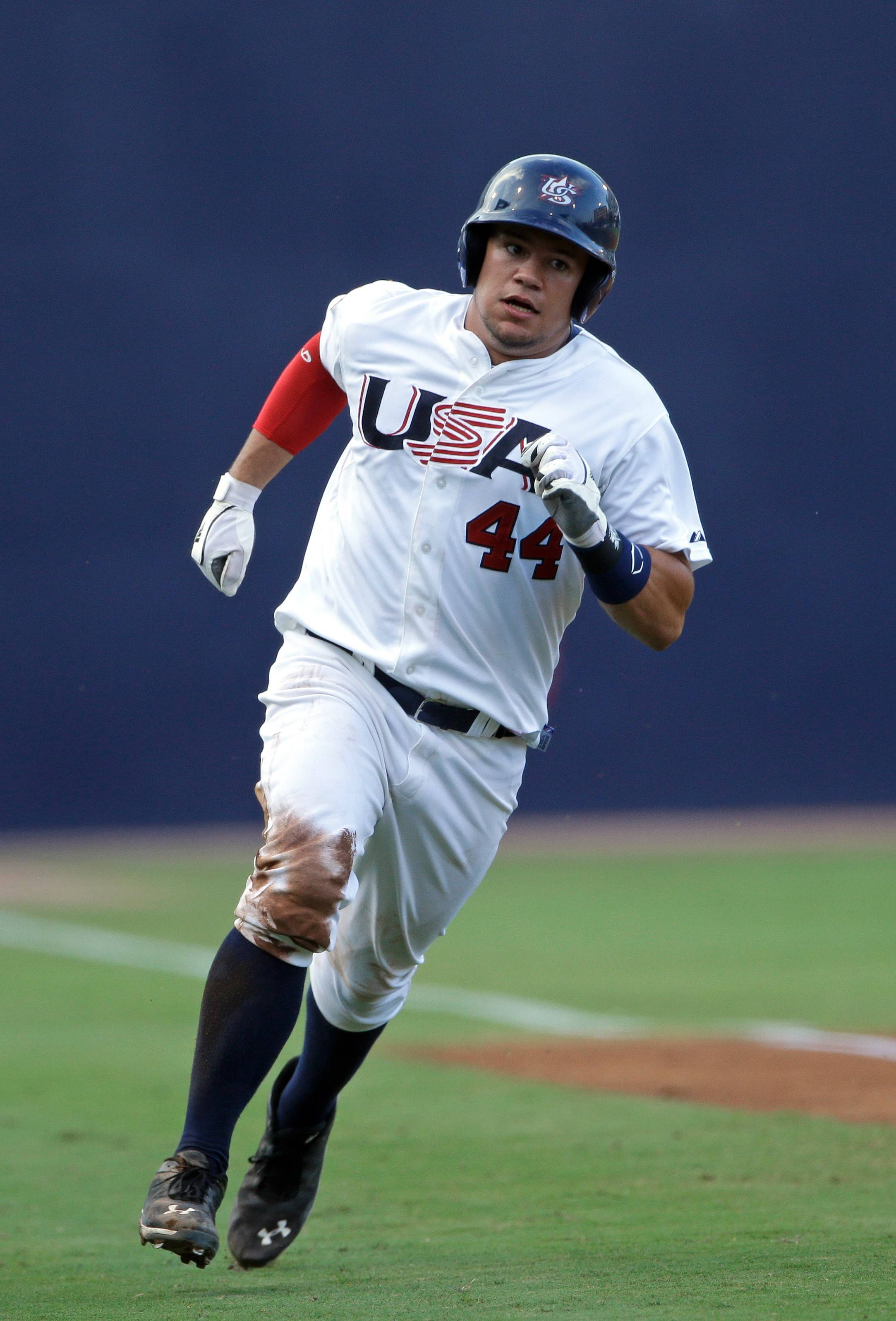 Associated PressThe United States' Kyle Schwarber (44) rounds third base heading for a run during a 2013 exhibition game against Cuba.