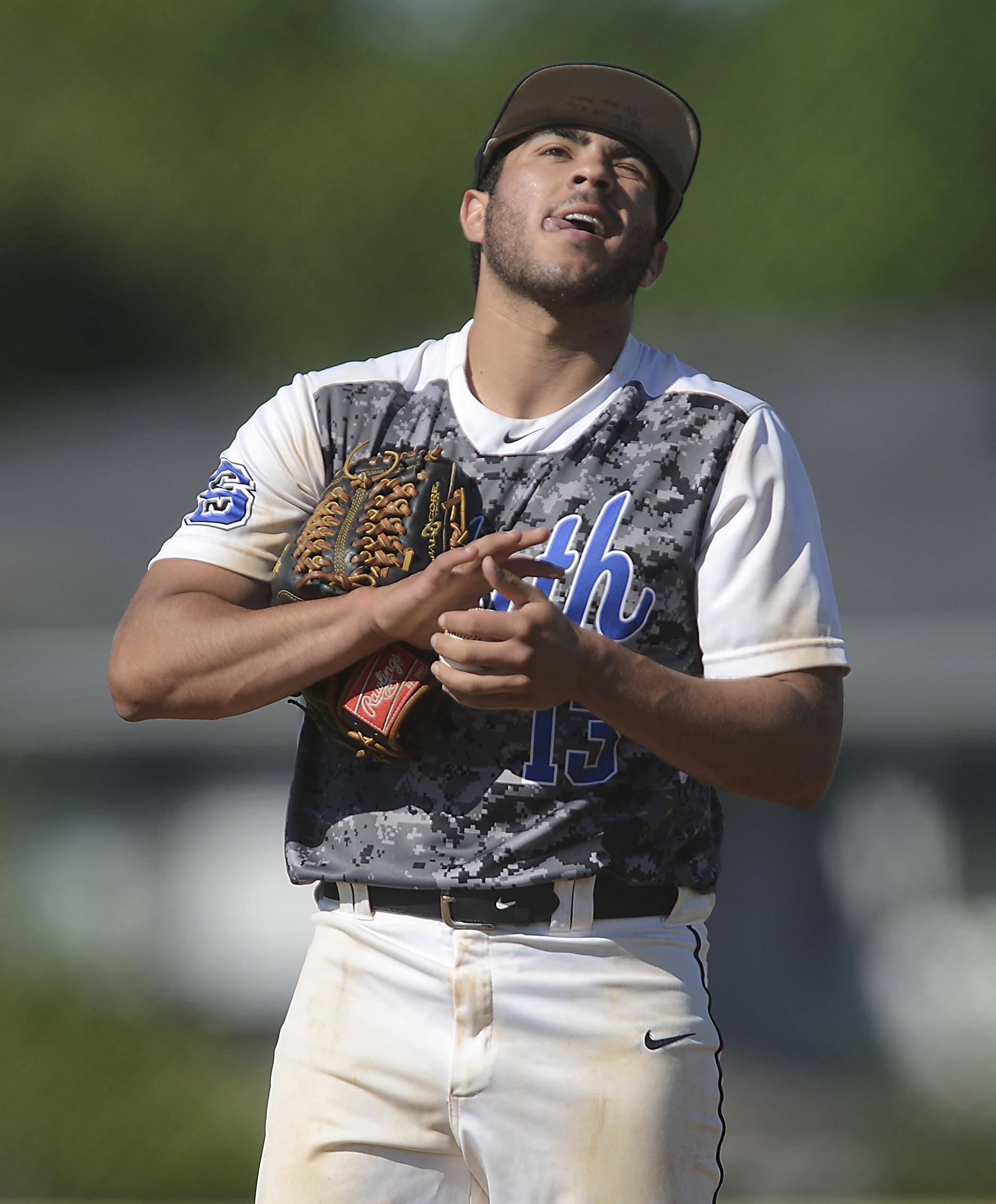 St. Charles North starting pitcher Frankie Farry reacts as South Elgin continues to score runs in the first inning in the Class 4A Schaumburg sectional semifinal game Thursday.