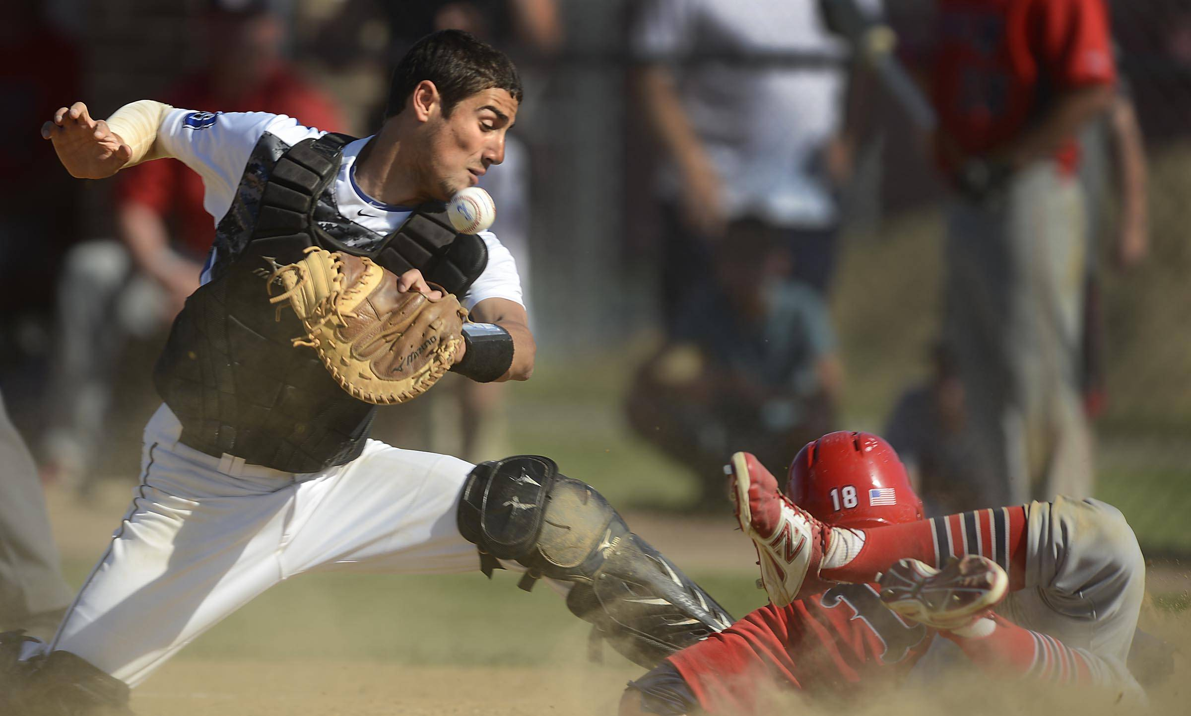 St. Charles North catcher Kyle Khoury loses the ball as he turns to tag South Elgin's Nick Menken in the first inning in the Class 4A Schaumburg sectional semifinal game Thursday.
