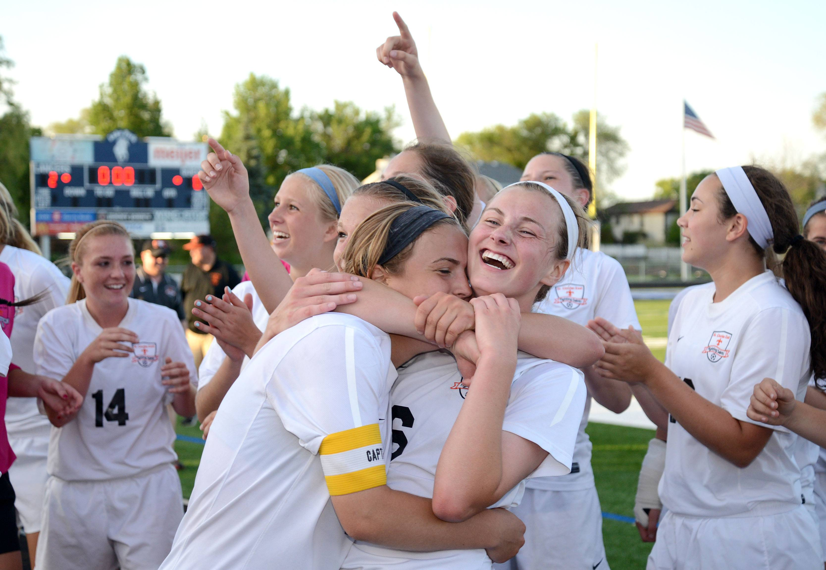 St. Charles East's Anna Corirossi, left, and Kelli Santo Paolo celebrate their win over Huntley in the Class 3A girls soccer supersectional at Lake Park High School in Roselle on Tuesday.