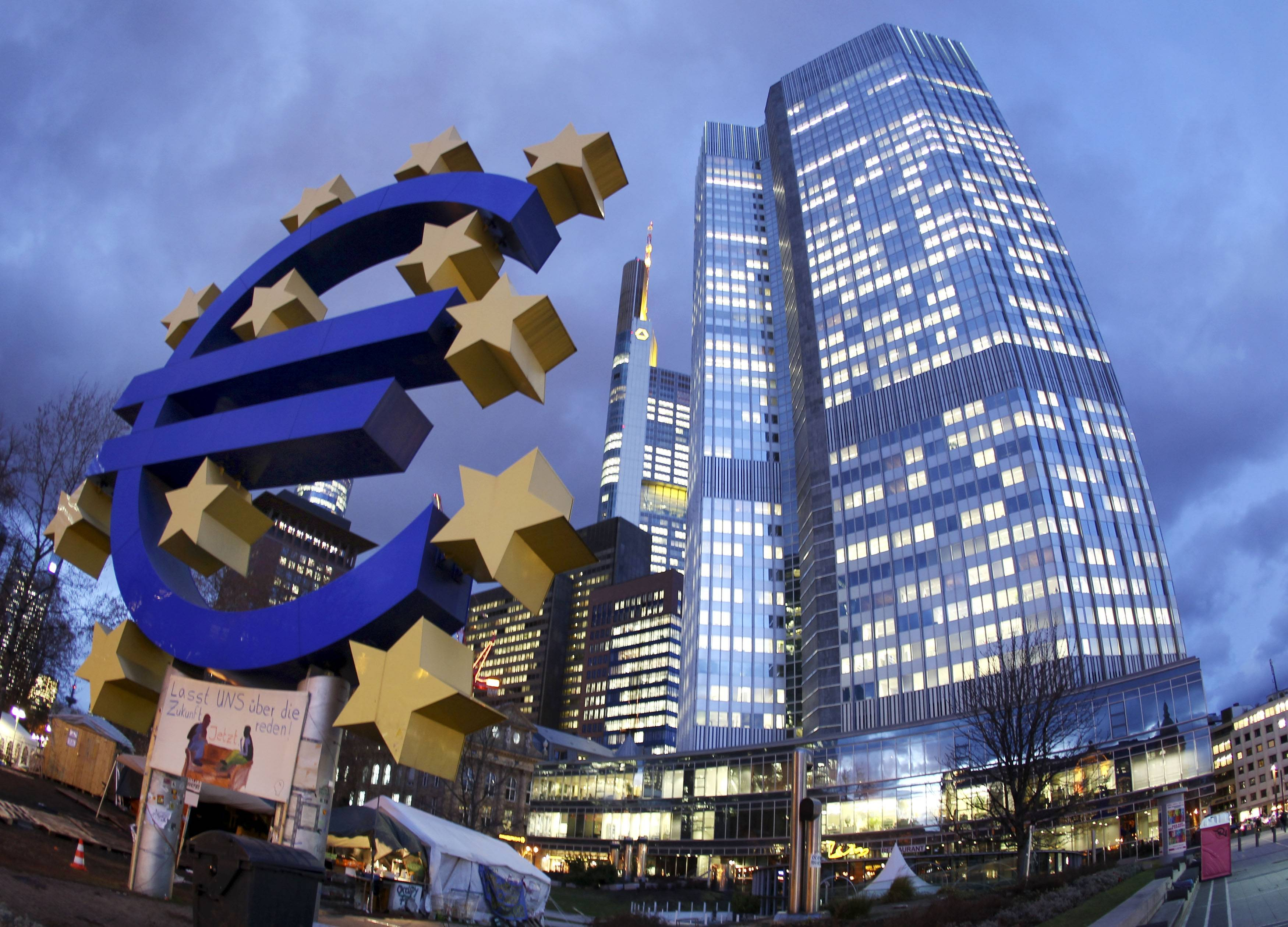 The Euro sculpture in front of the European Central Bank, right, in Frankfurt, Germany. The European Central Bank took bold steps Thursday to protect Europe's fragile economic recovery, cutting interest rates and offering to pump more money into the financial system.
