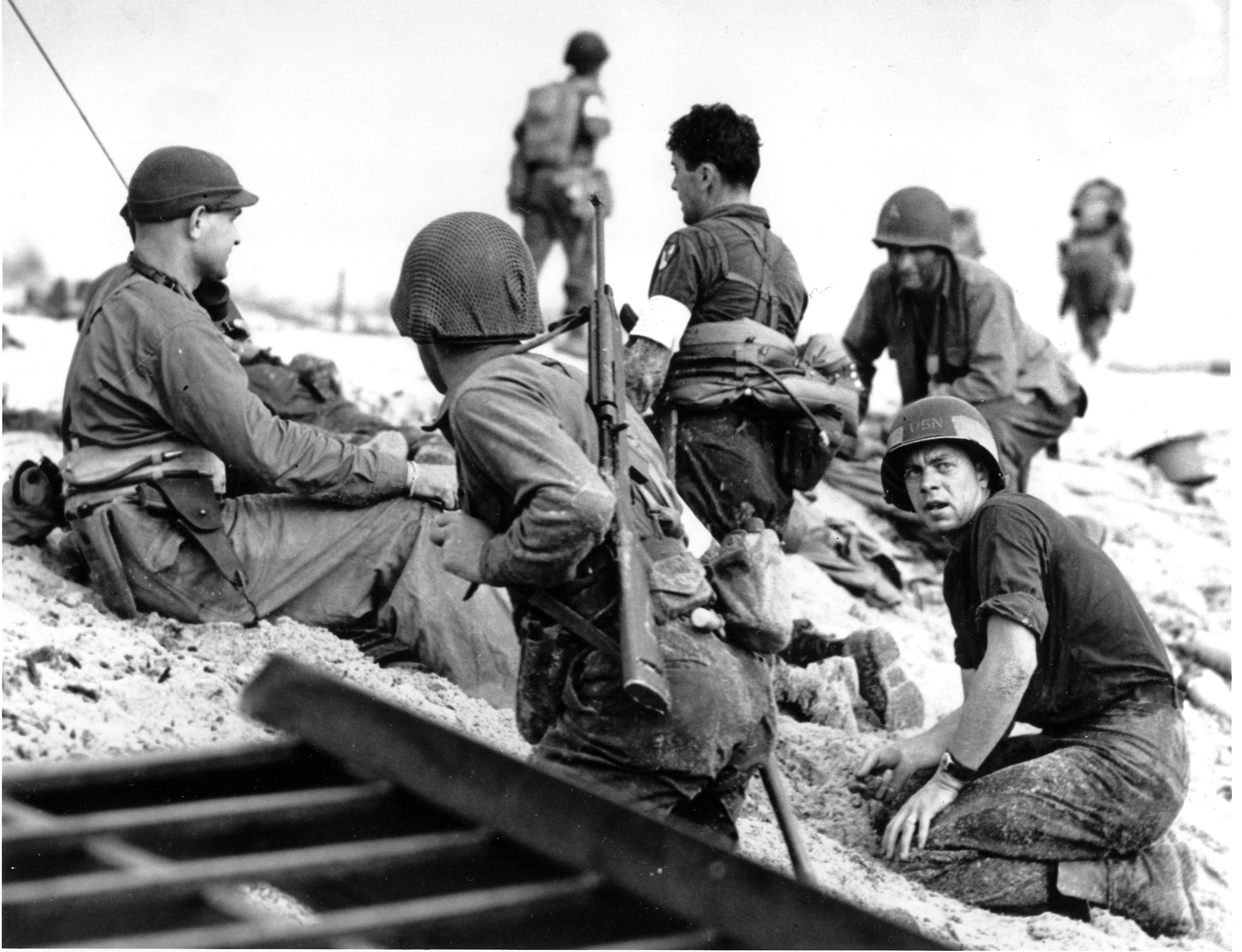 A first wave beach battalion Ducks lays low under the fire of Nazi guns on the beach of southern France on D-Day, June 6, 1944 during World War II. One invader operates a walkie talkie radio directing other landing craft to the safest spots for unloading their parties of fighting men. (AP Photo)