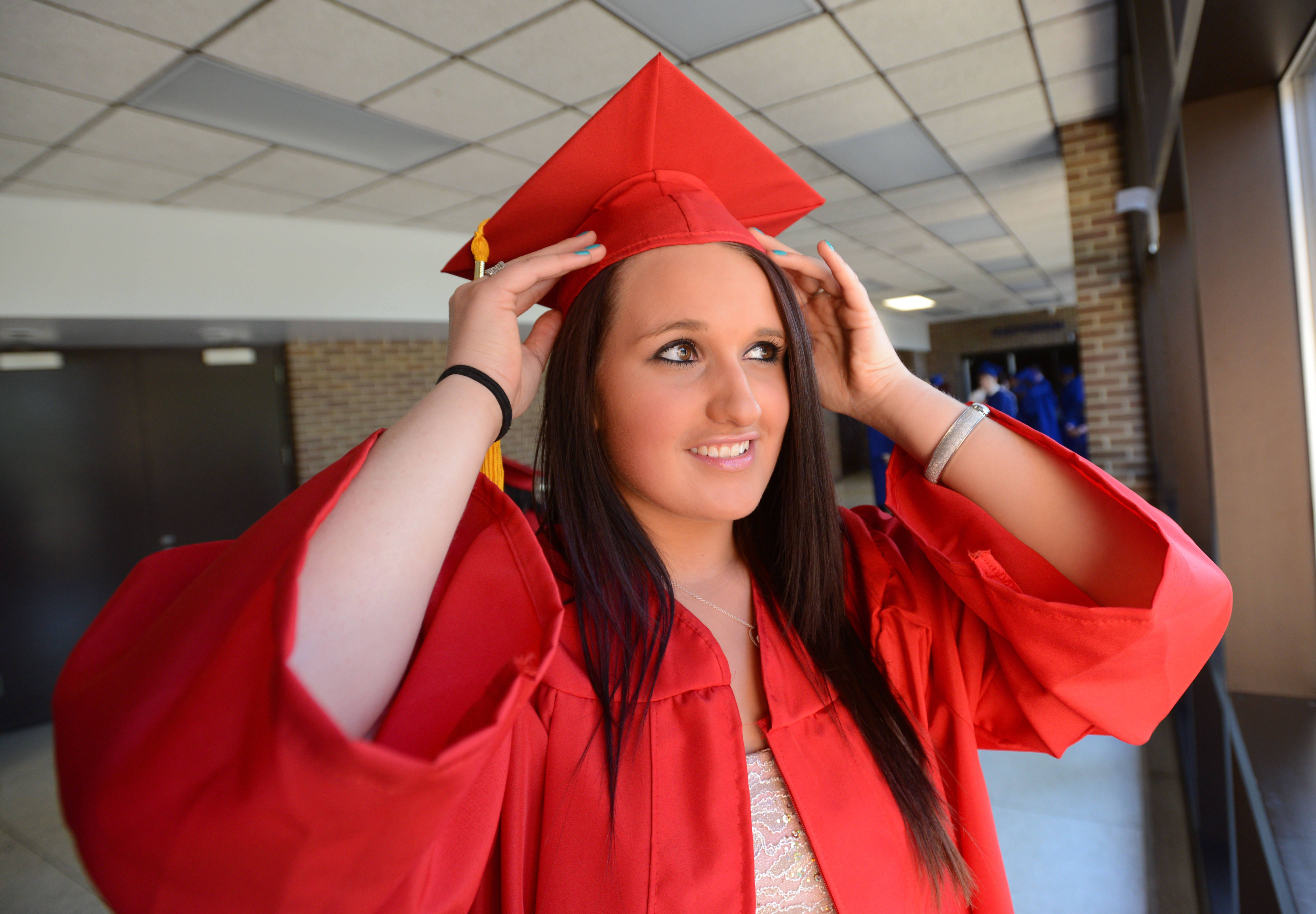 Kayla Ellingwood,18, of Wheaton makes a final adjustment before the start of the Glenbard South High School Graduation Friday.