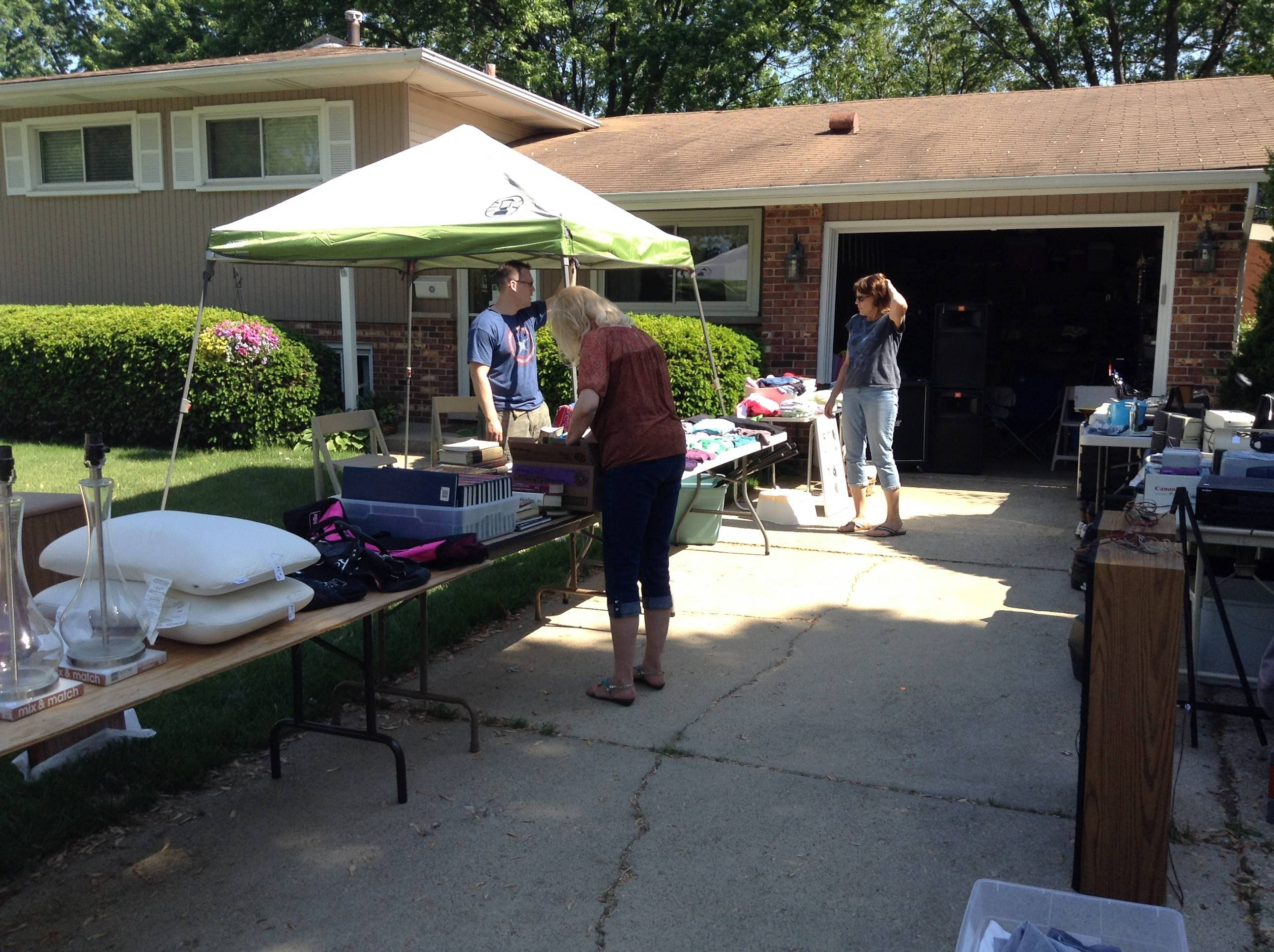A Timbercrest subdivision family inventories their items for sale Friday afternoon following the morning rush on the first day of the three-day Timbercrest-Woods Garage Sale in Schaumburg.