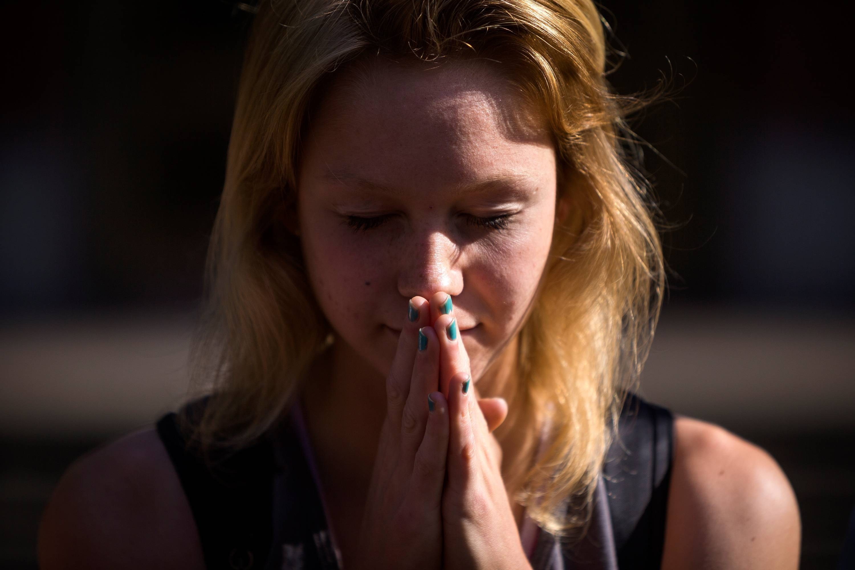 Following the lift of a lockdown in the wake of a school shooting, Seattle Pacific University students pray together Thursday, June 5, 2014, on the campus of Seattle Pacific University in Seattle, Wash.