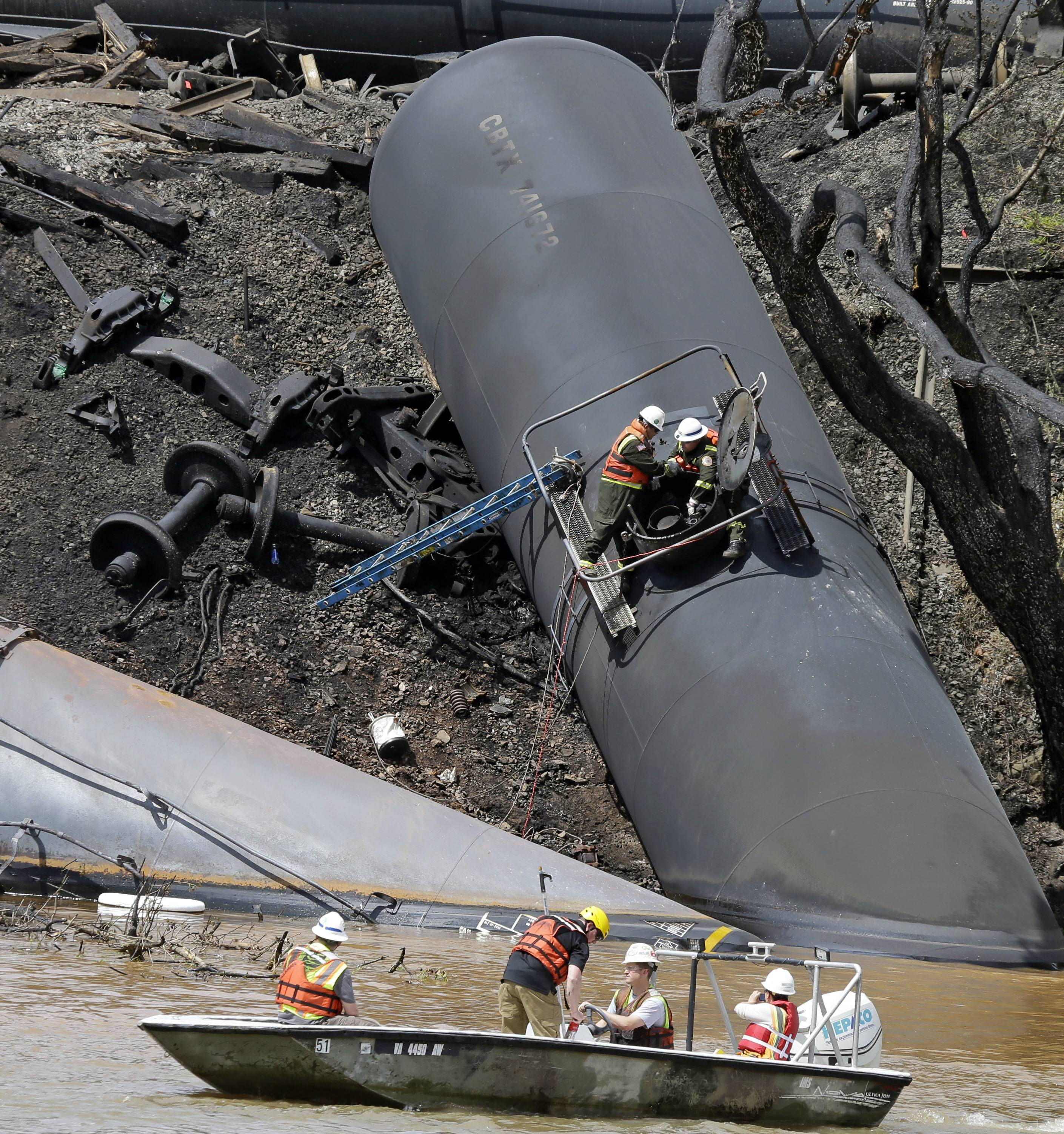 The site where several CSX tanker cars carrying crude oil derailed and caught fire along the James River near downtown Lynchburg, Va.