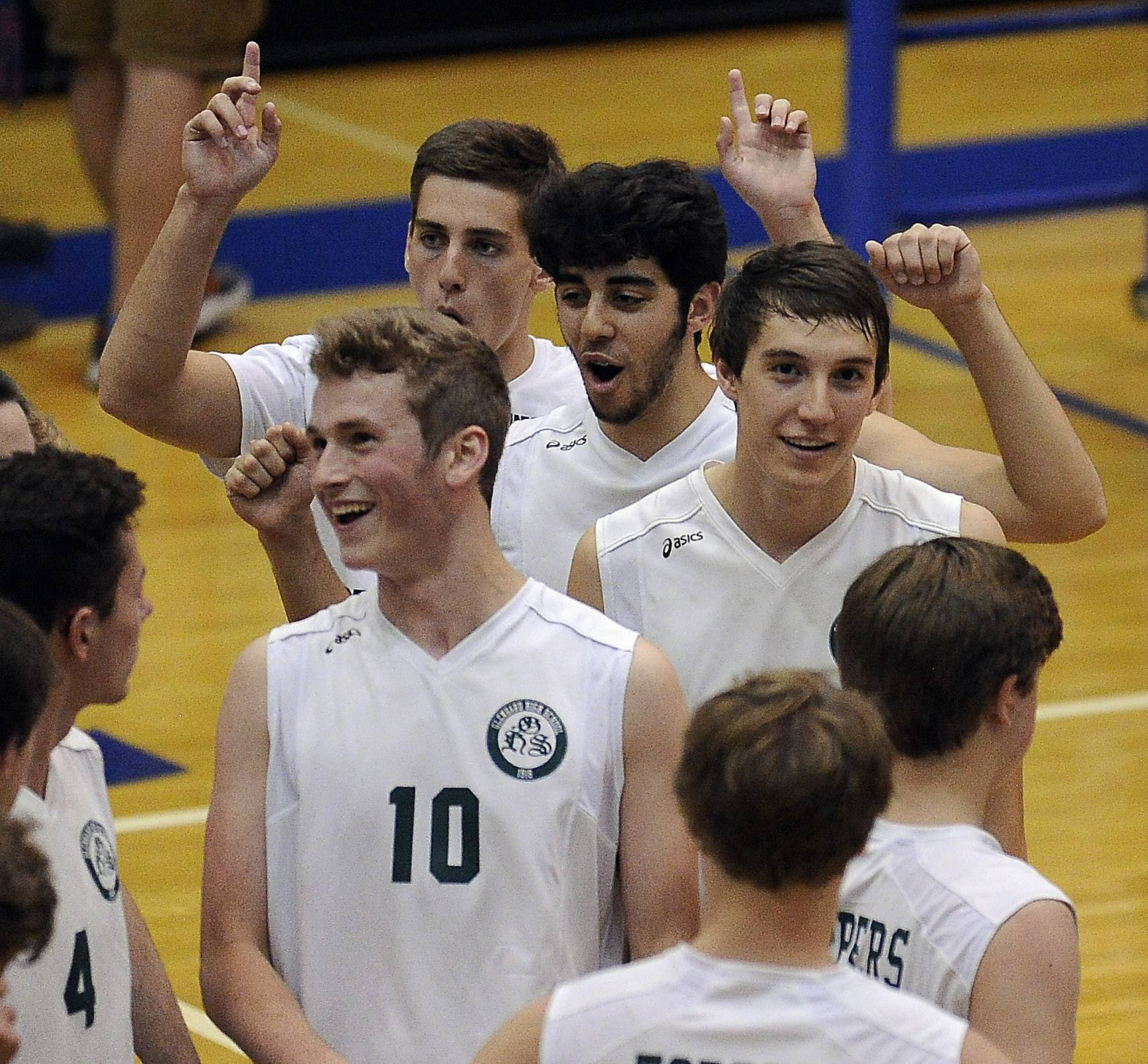 Glenbard West's Jackson Nagle (10) celebrates with his teammates against Morton in game two of the boys volleyball state quarterfinals at Hoffman Estates High School.