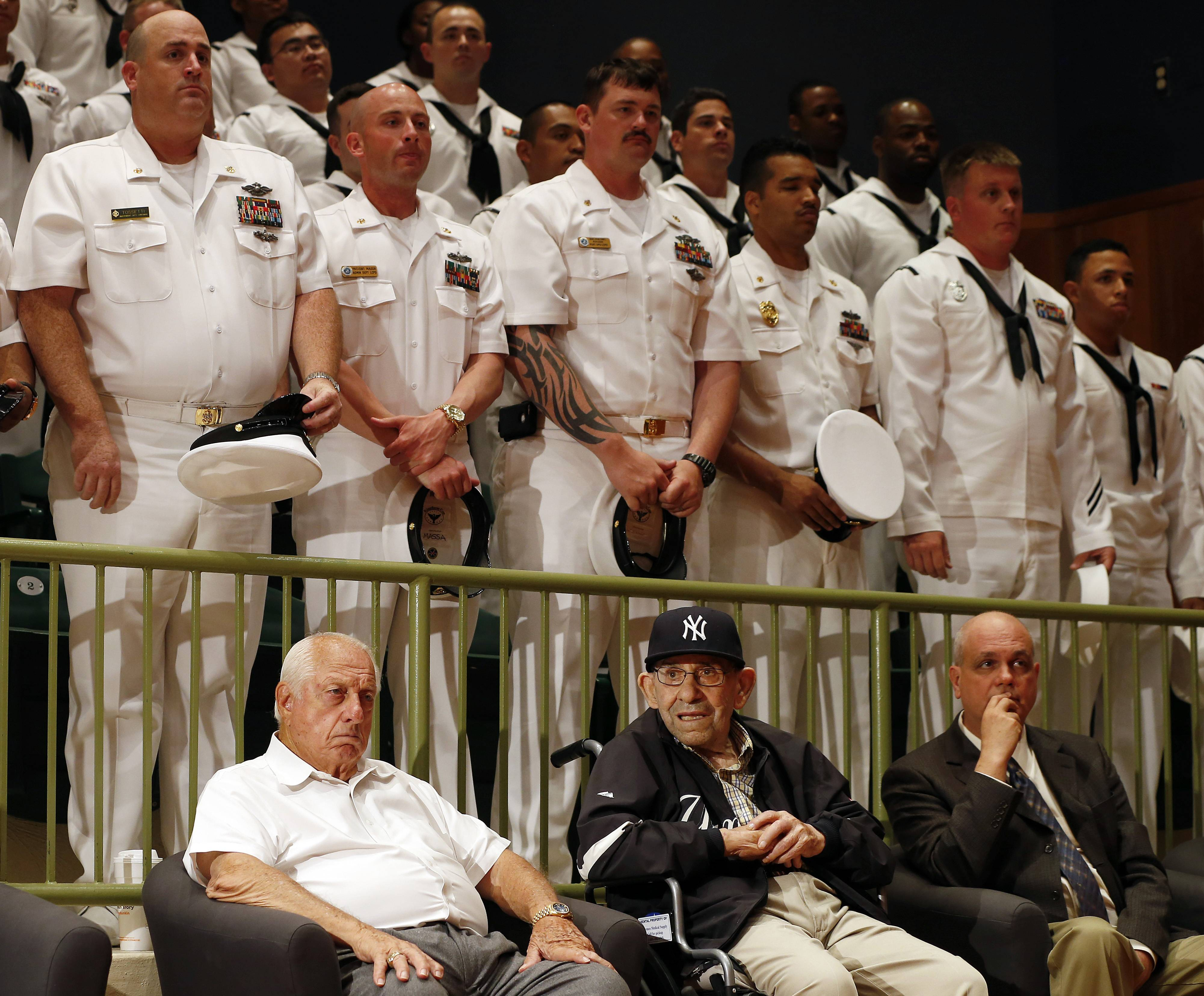 Former Los Angeles Dodger manager Tommy Lasorda, front left, joins Yogi Berra, who is honored by the U.S. Navy for his service 70 years ago in the D-Day Invasion during a ceremony, Friday, June 6, 2014, at the Yogi Berra Museum in Montclair, N.J.