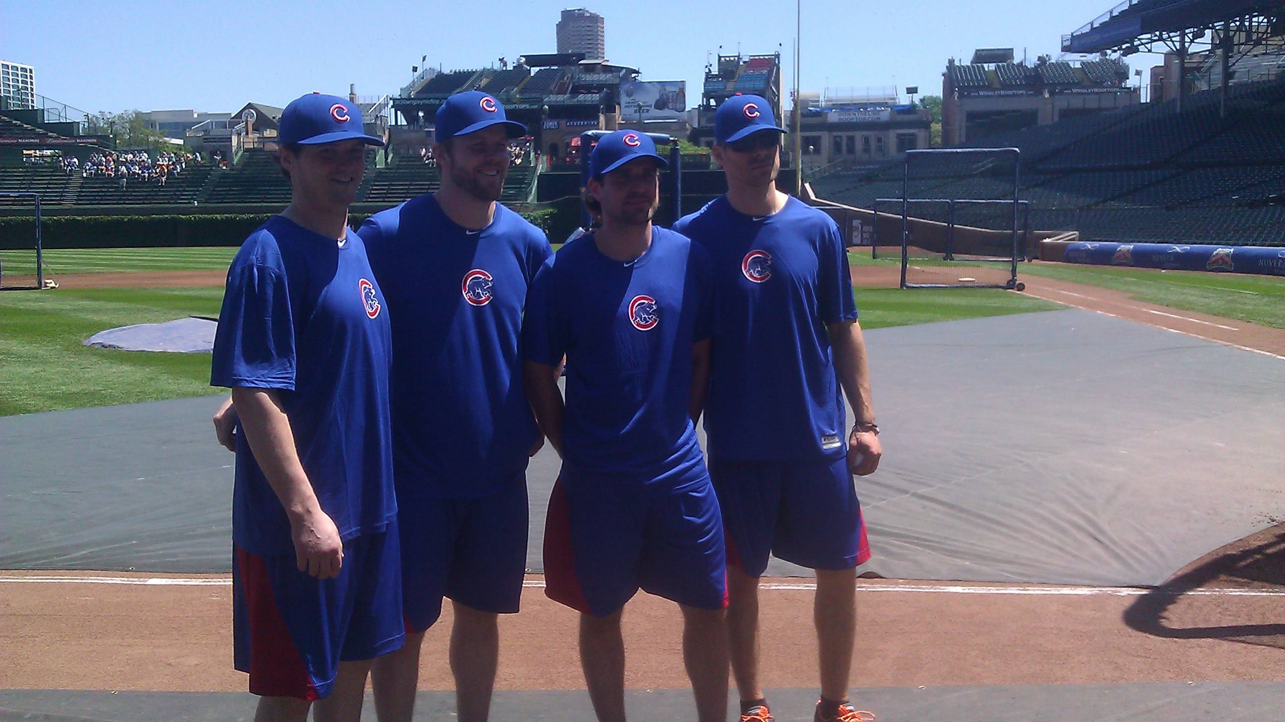 Four members of the Chicago Blackhawks, Sheldon Brookbank, left, Bryan Bickell, Patrick Sharp and Michal Handzus, tested their baseball skills Friday at Wrigley Field when they took part in batting practice.