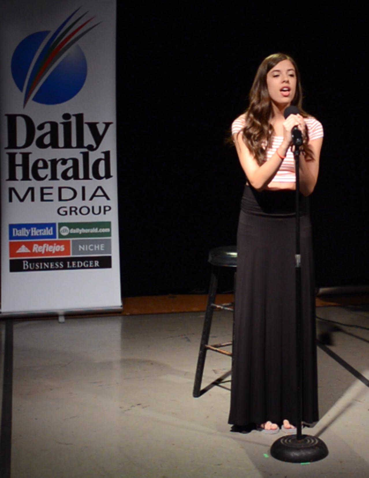 Alyssa Peterson, 18, of Hoffman Estates performs a song during Thursday's auditions for the Suburban Chicago's Got Talent competition at the Prairie Center for the Arts in Schaumburg.