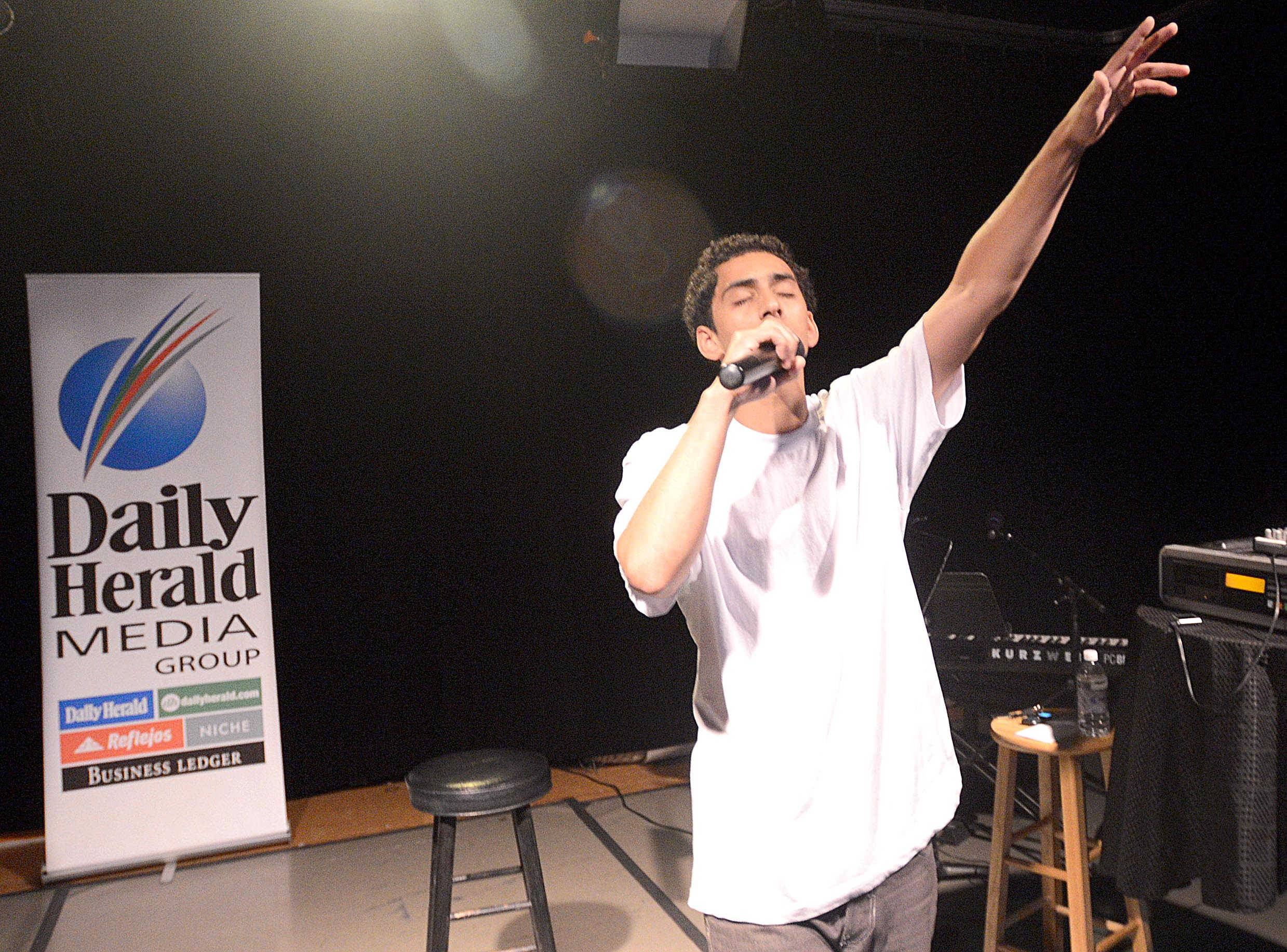 Jordan Madonia, 20, of Hoffman Estates raps during Thursday's auditions for the Suburban Chicago's Got Talent competition at the Prairie Center for the Arts in Schaumburg.