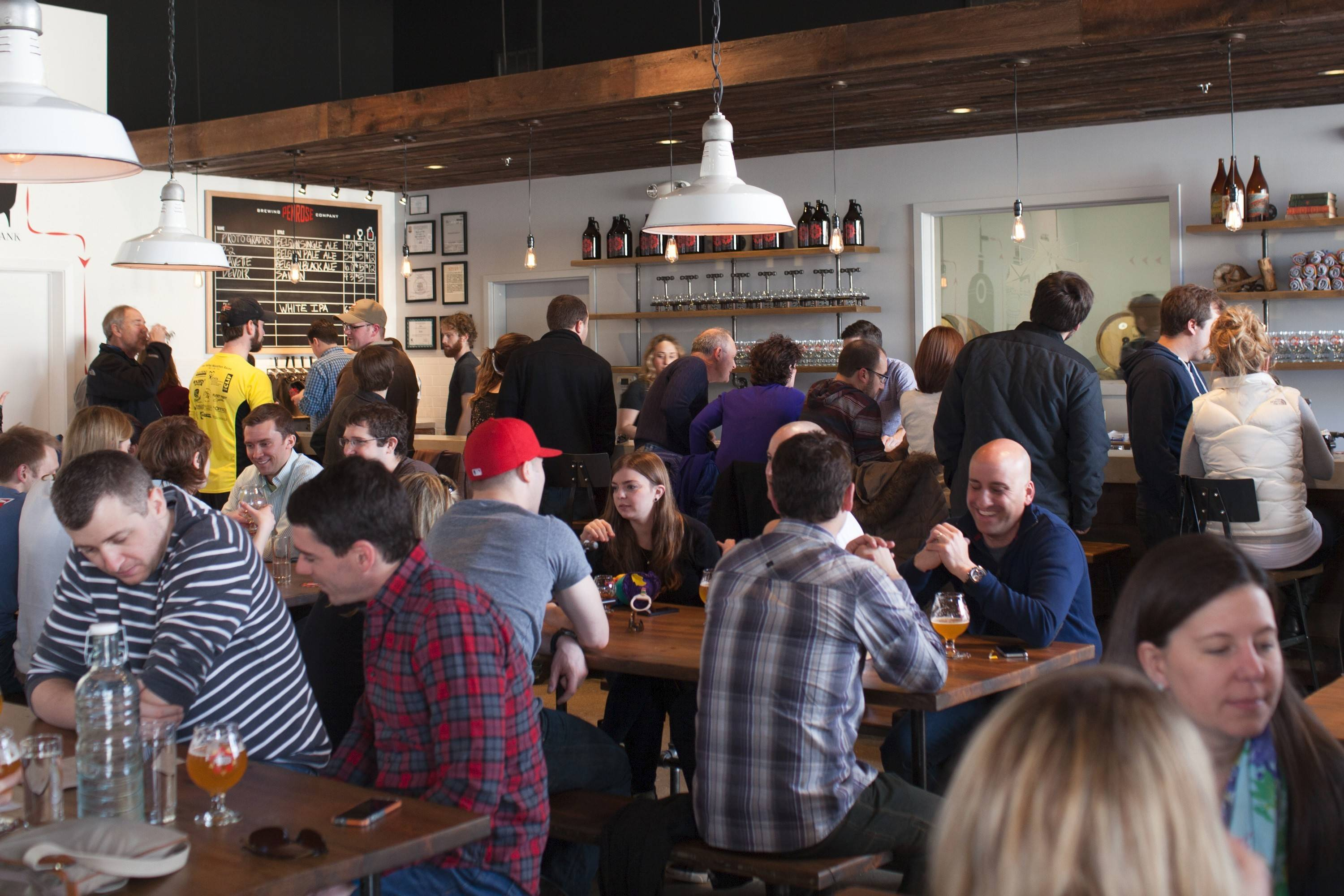 Patrons fill Penrose Brewing Company's taproom on a recent afternoon.