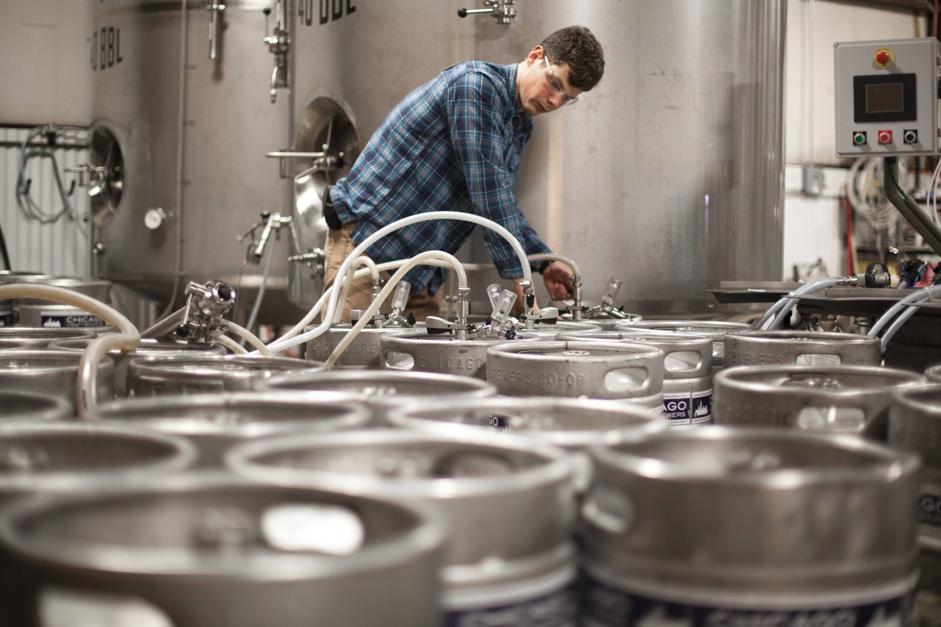 Penrose Brewing Company's brewmaster Tom Korder fills kegs of beer in the Geneva brewery's packaging area.