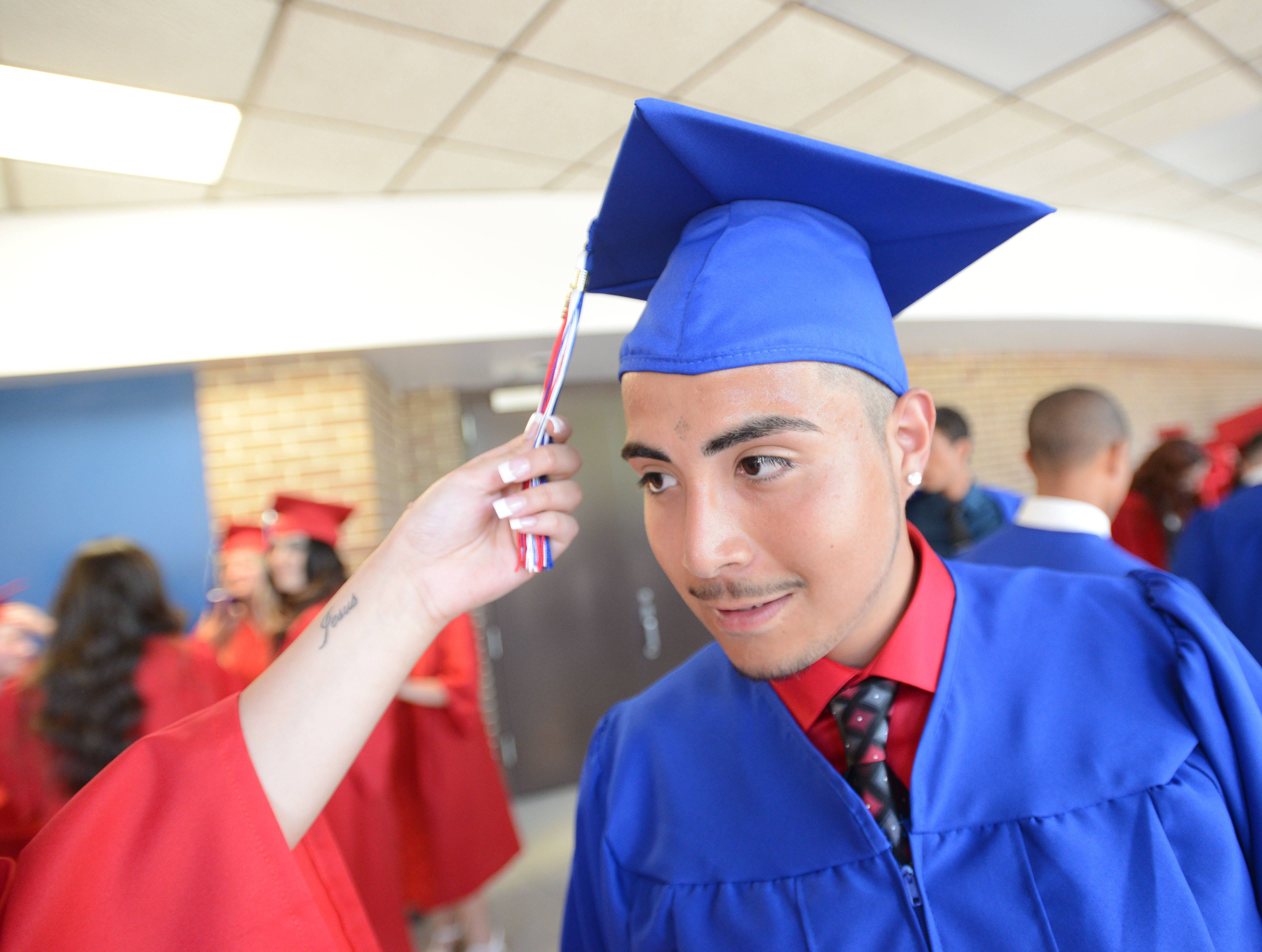 Jose Vazquez,18, of Wheaton get some hep with his cap.