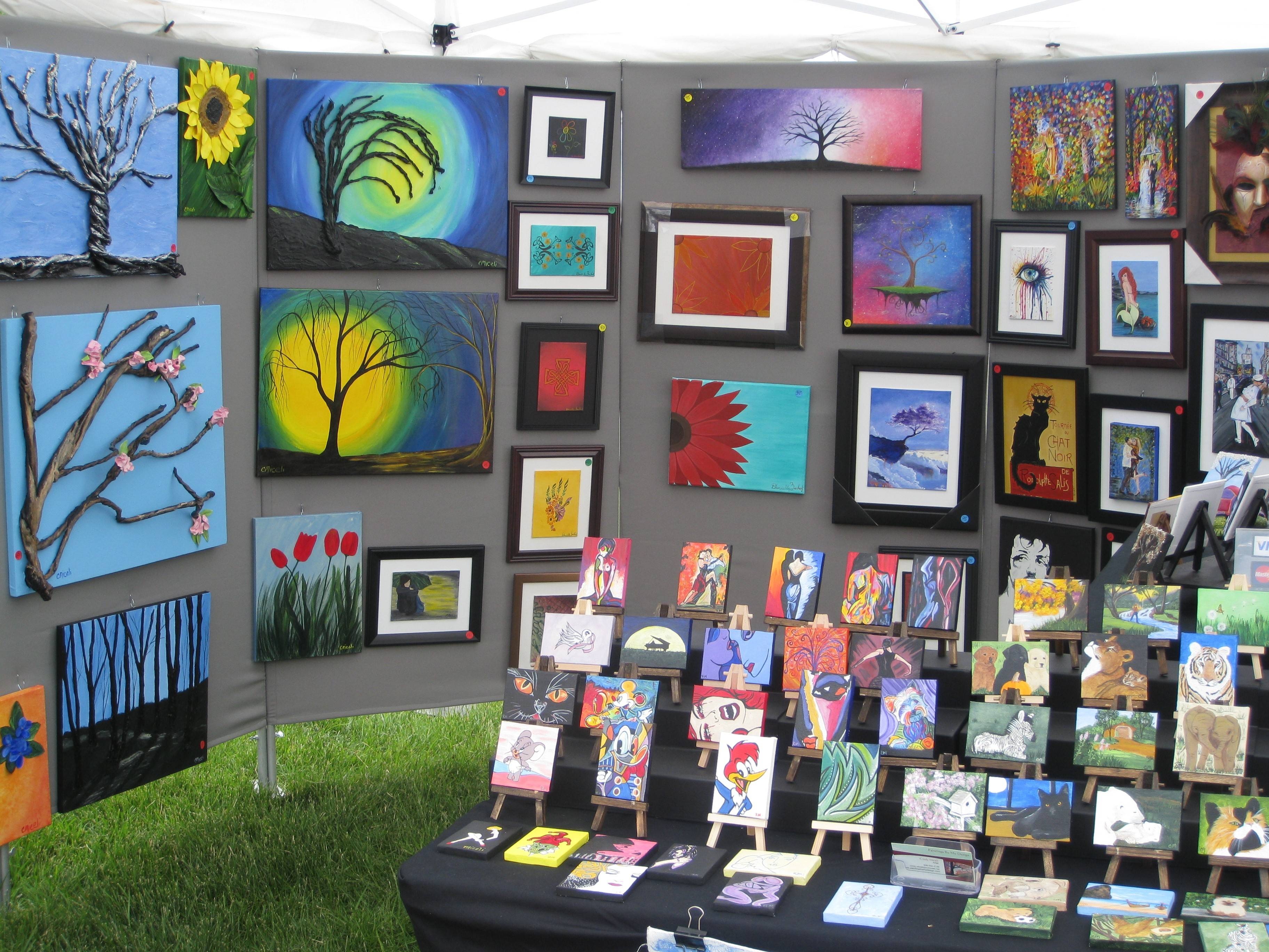 A tent full of colorful pieces, at a previous Elk Grove Park District Art in the Park