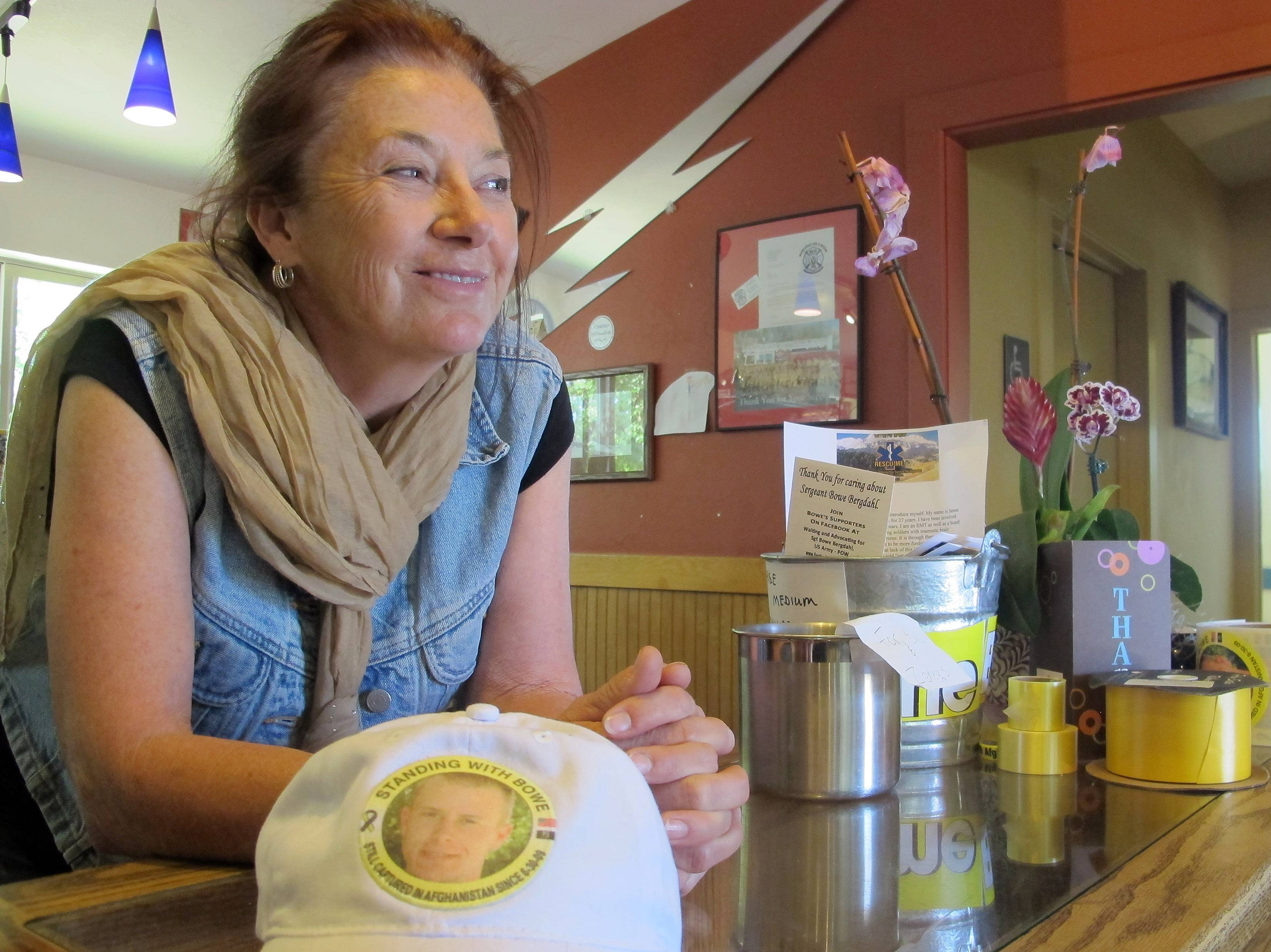 Sue Martin, a Bergdahl family friend and owner of Zaney's Coffee Shop in downtown Hailey, Idaho, leans on the counter in her shop watching the crowd of media on the street outside Thursday, June 5, 2014. Martin closed her shop following Bowe Bergdahl's release in a prisoner swap with the Taliban to focus on serving as the family spokesperson.