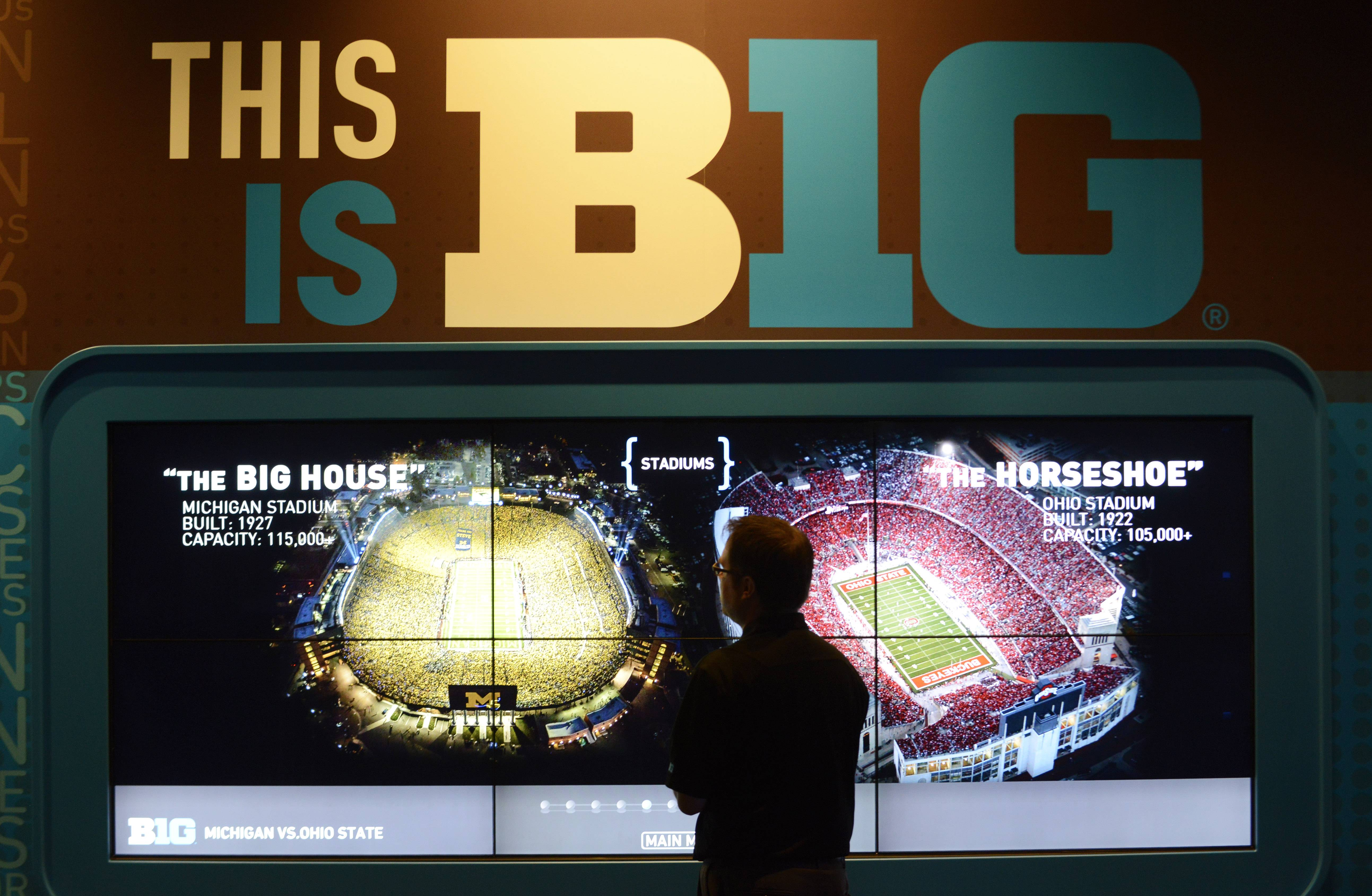 Adam Augustine, Big Ten spokesman, stands in front of a display at the new interactive Big Ten Museum, which opens Saturday in Rosemont.