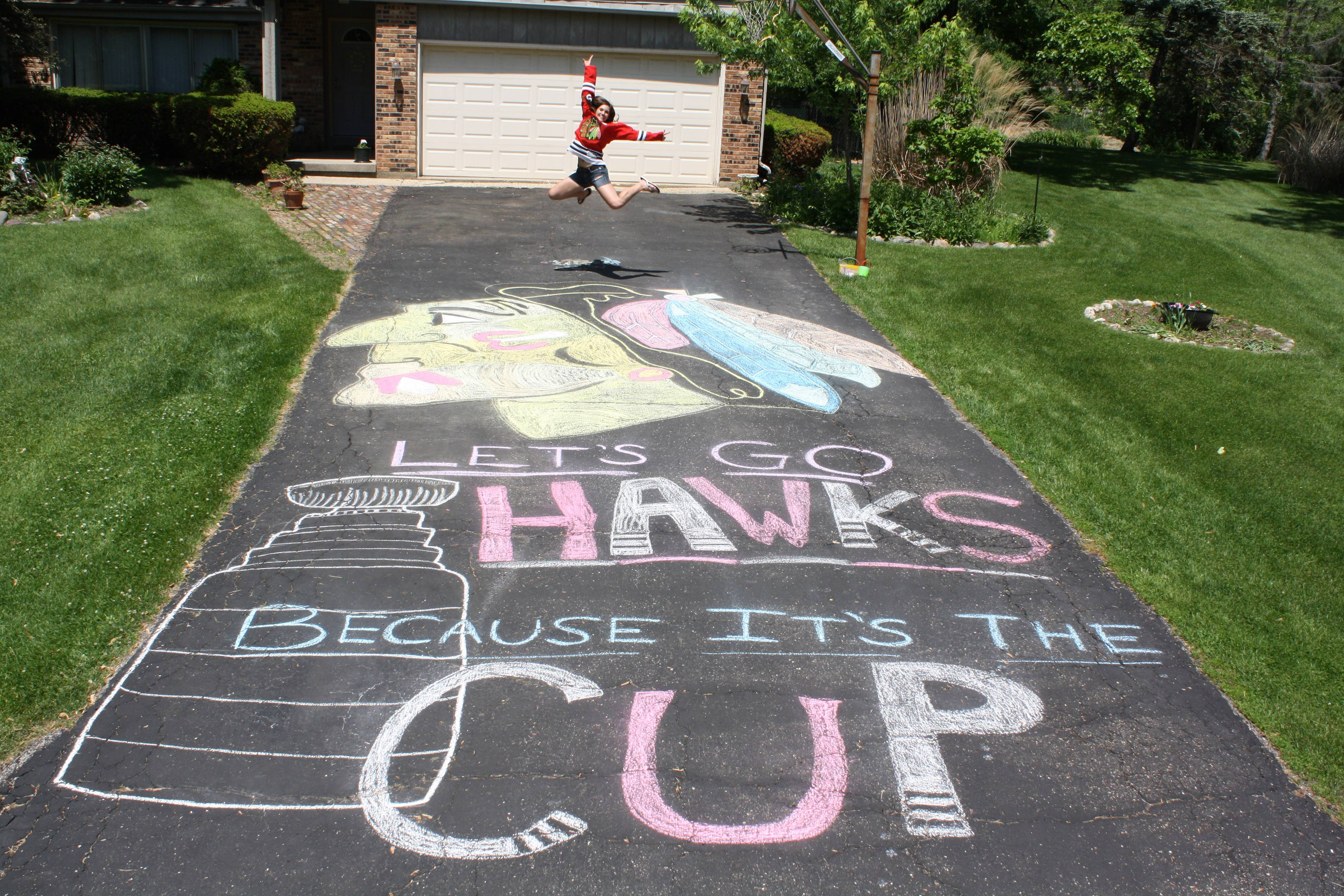 After going to the Blackhawk's game last Wednesday, my daughter who has been a fan for years, got inspired to show off her team spirit and loyalty! Her creativity ended up giving us one of the coolest and most popular driveways in the neighborhood!
