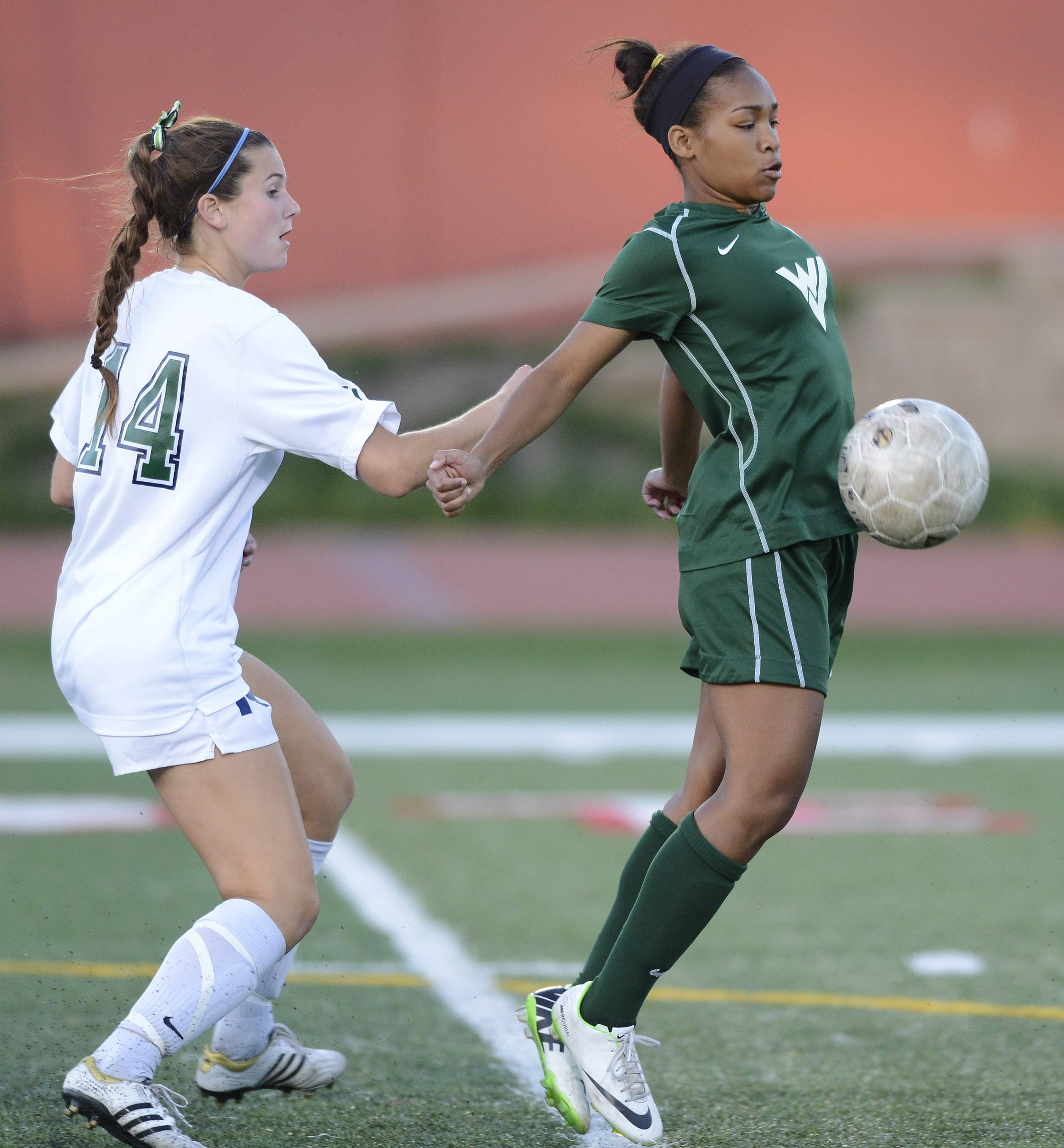 Waubonsie Valley's Kristen Dodson, right, tries to control the ball in front of New Trier's Sarah Connors during the girls soccer Class 3A state semifinal at North Central College in Naperville Friday.