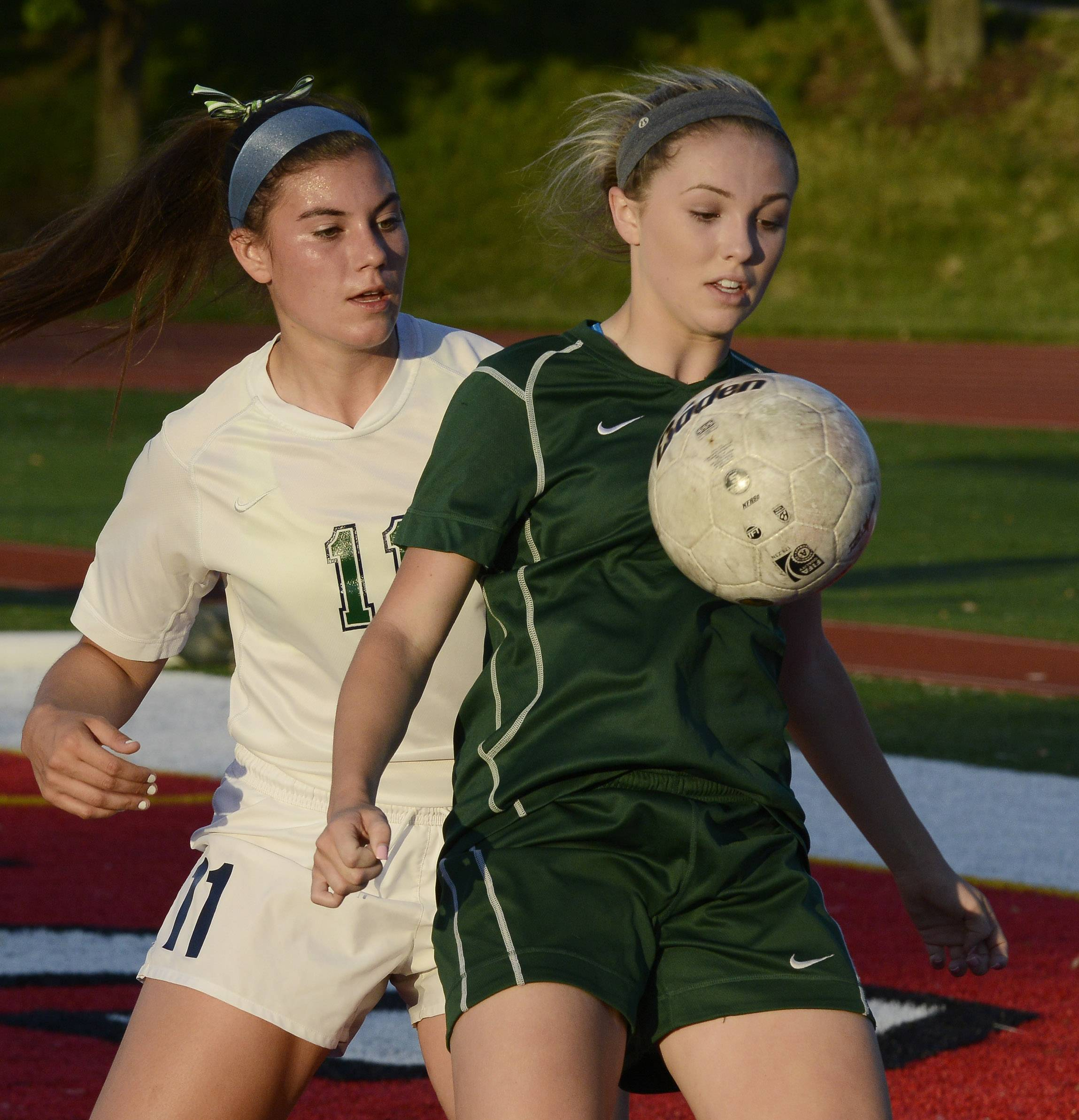 Waubonsie Valley's Maggie Roe gets in front of New Trier's Alex Bukovac after a throw-in during the girls soccer Class 3A state semifinal at North Central College in Naperville Friday.