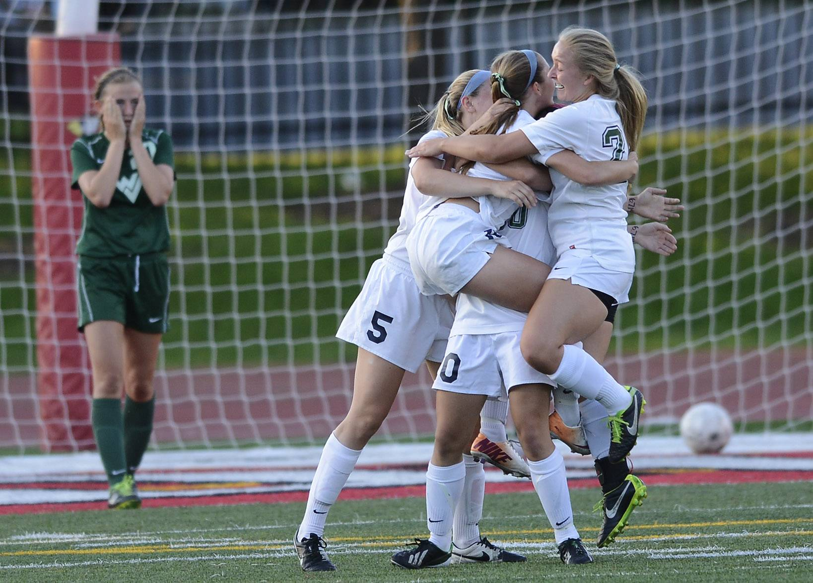 New Trier celebrates after scoring the game's only goal during the girls soccer Class 3A state semifinal against Waubonsie Valley at North Central College in Naperville Friday.