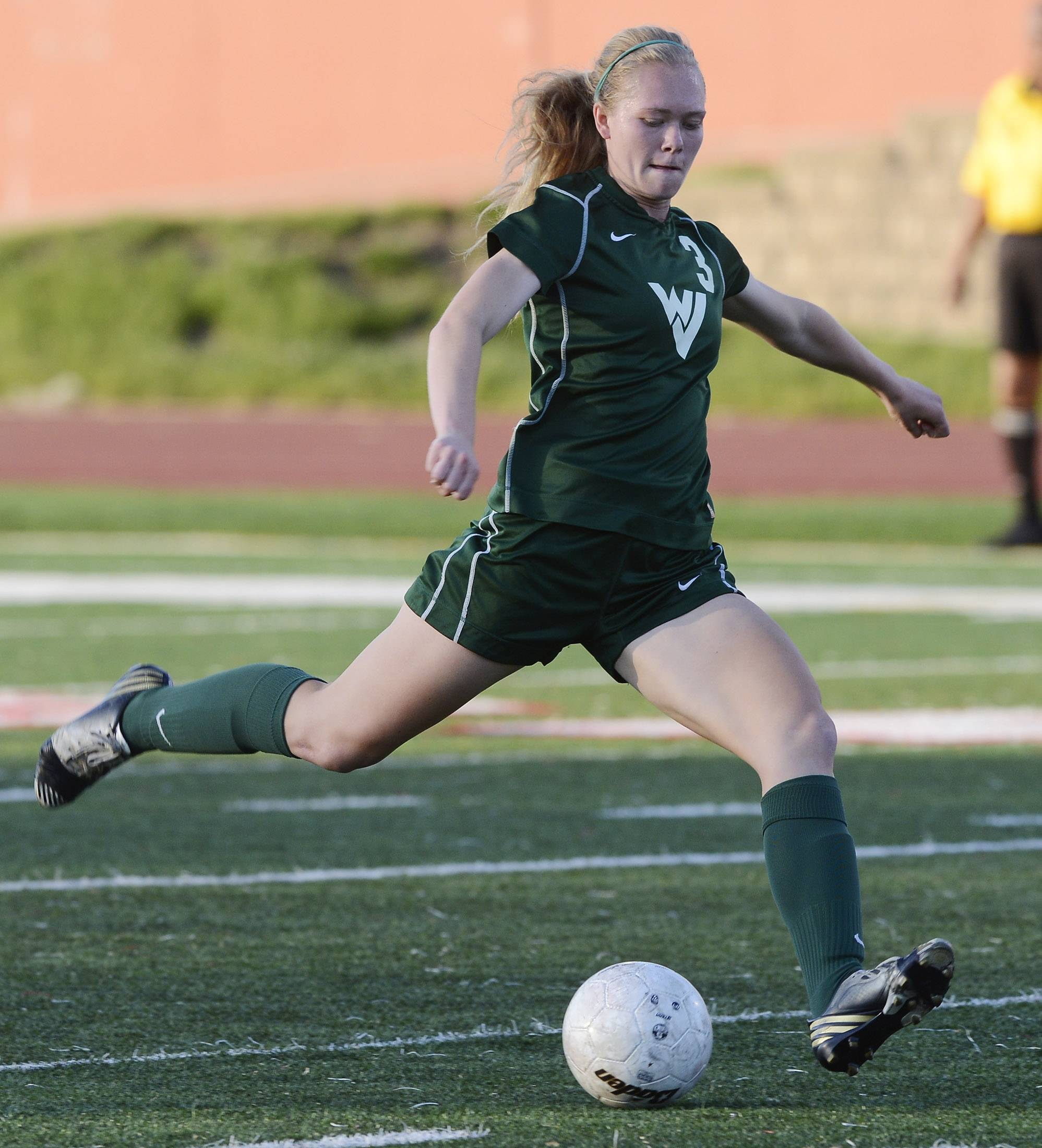 Waubonsie Valley's Morgan Kemerling takes a shot on goal during the girls soccer Class 3A state semifinal against New Trier at North Central College in Naperville Friday.