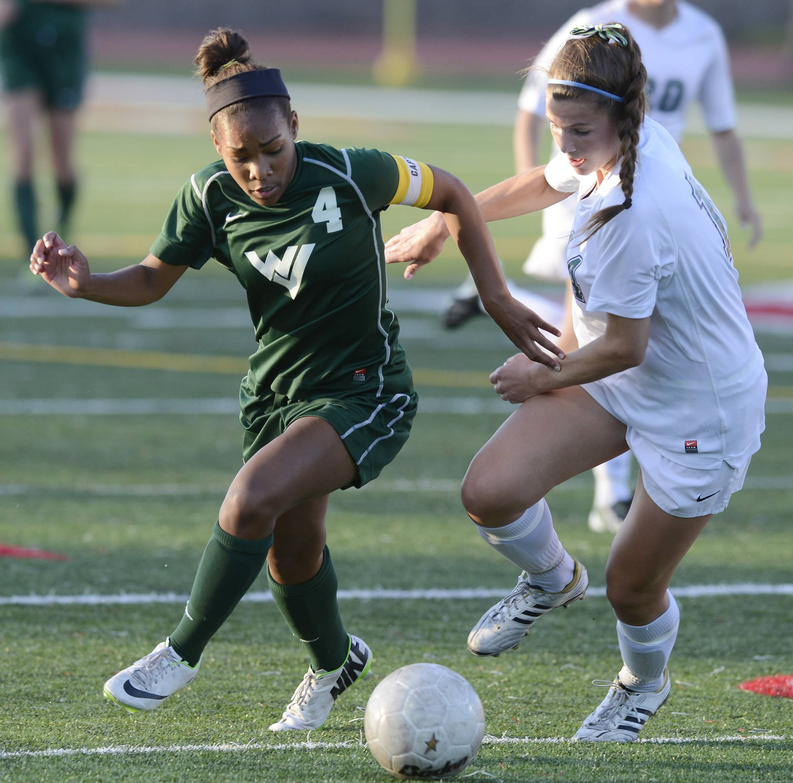Waubonsie Valley's Kristen Dodson, left, tries to get past New Trier's Sarah Connors during the girls soccer Class 3A state semifinal at North Central College in Naperville Friday.