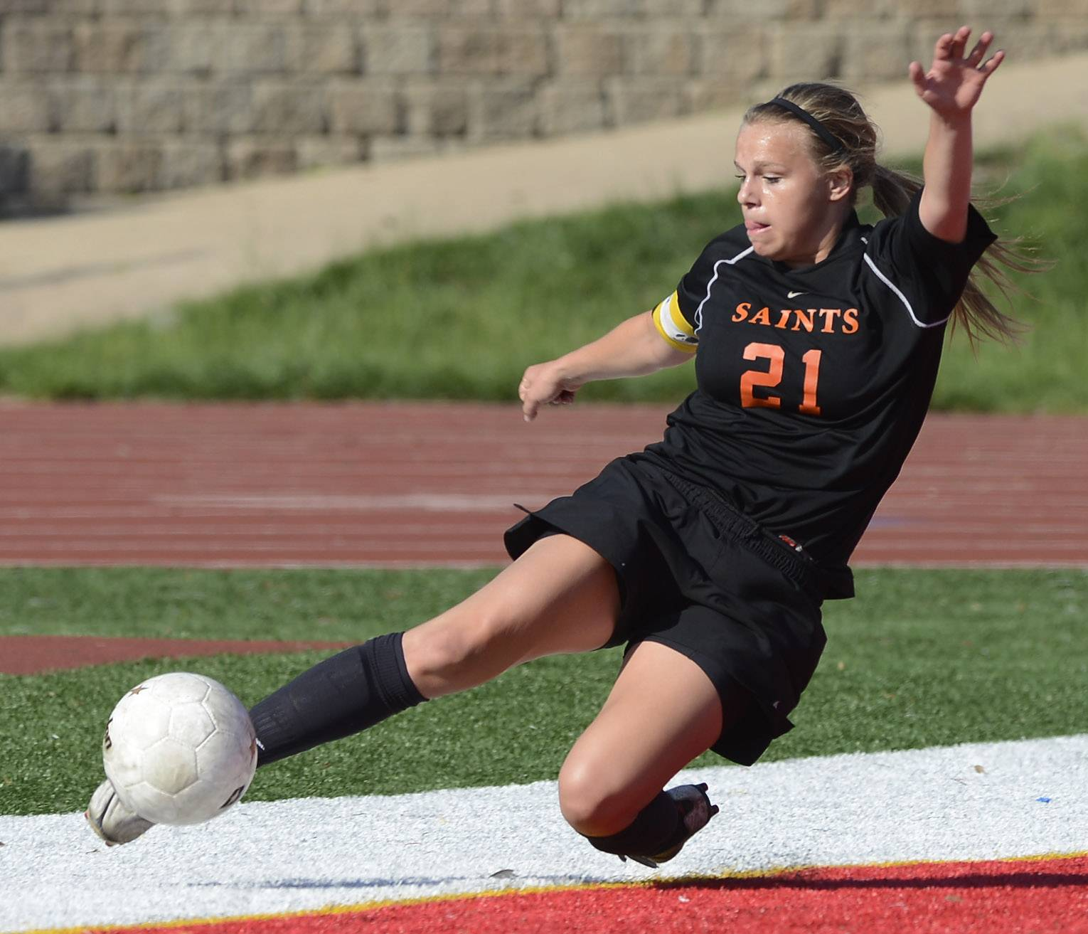 Amanda Hilton of St. Charles East tries to keep the ball in play during the girls soccer Class 3A state semifinal against Lincoln Way North at North Central College in Naperville Friday.
