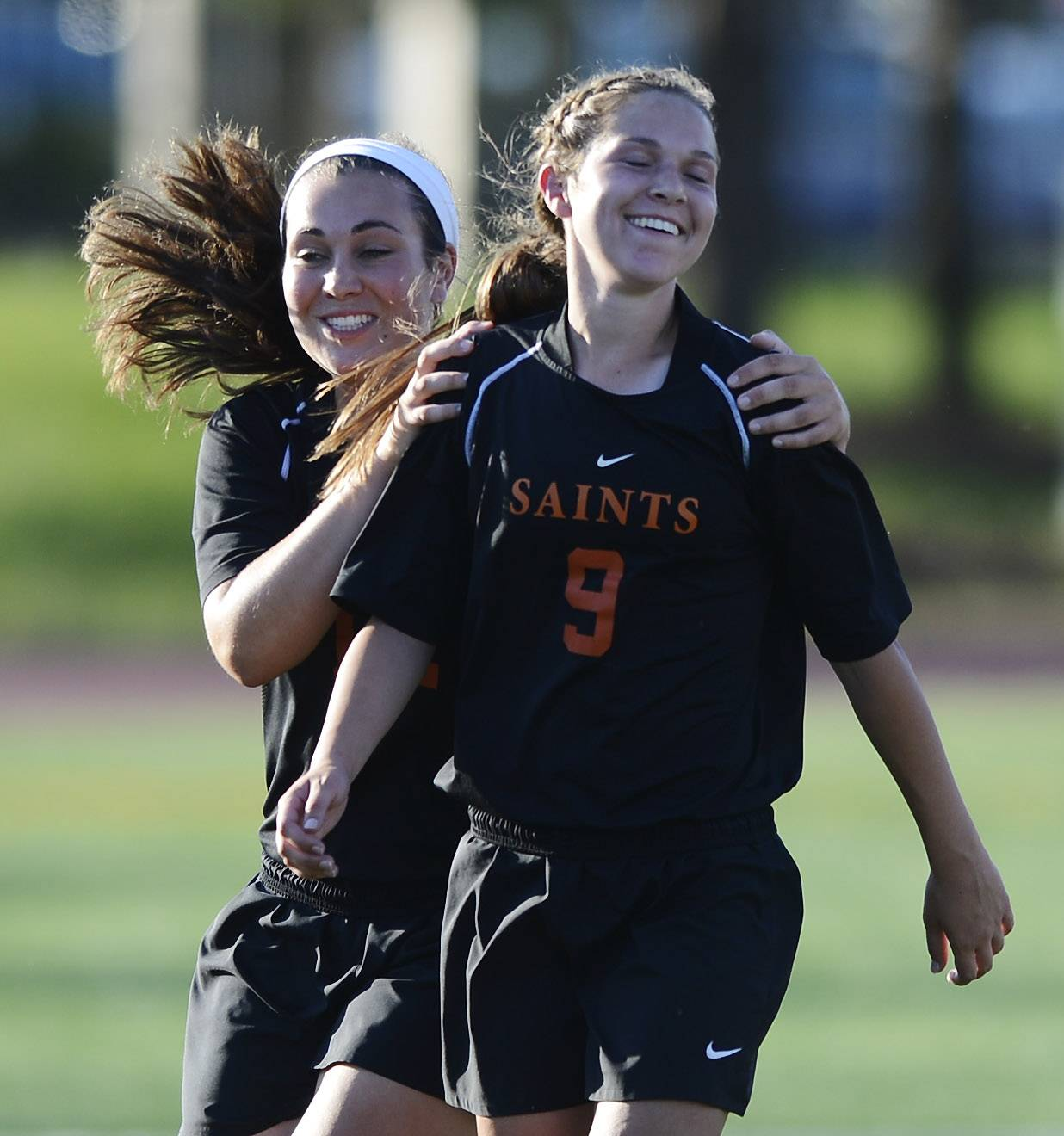 Shannon Gatehouse, left, and Darcy Cunningham of St. Charles North celebrate their win over Lincoln Way North during the girls soccer Class 3A state semifinal at North Central College in Naperville Friday.