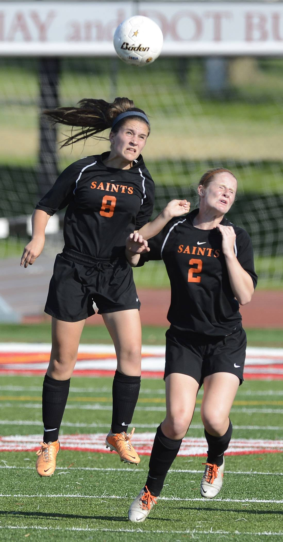 Sarah Beutow, left, and Julia Peterson of St. Charles East both leap for a header during the girls soccer Class 3A state semifinal against Lincoln Way North at North Central College in Naperville Friday.