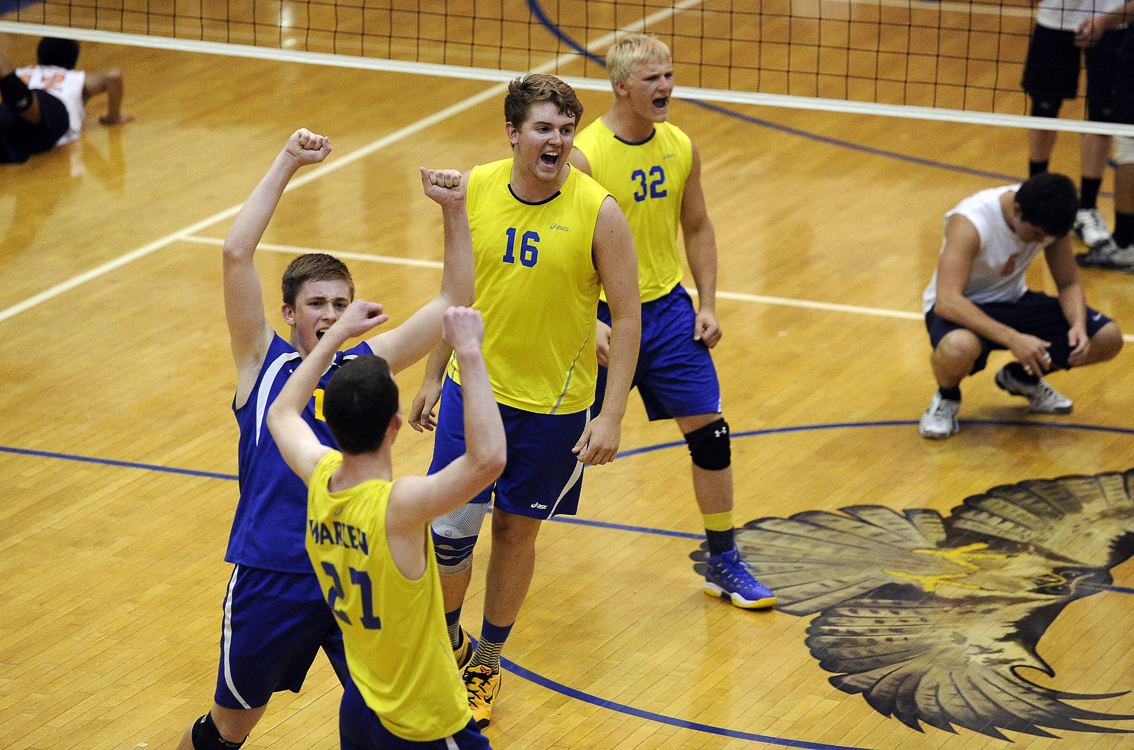 Warren's Mitch Maan de kok (16) celebrates his team's victory over Payton after set two Friday at Hoffman Estates.
