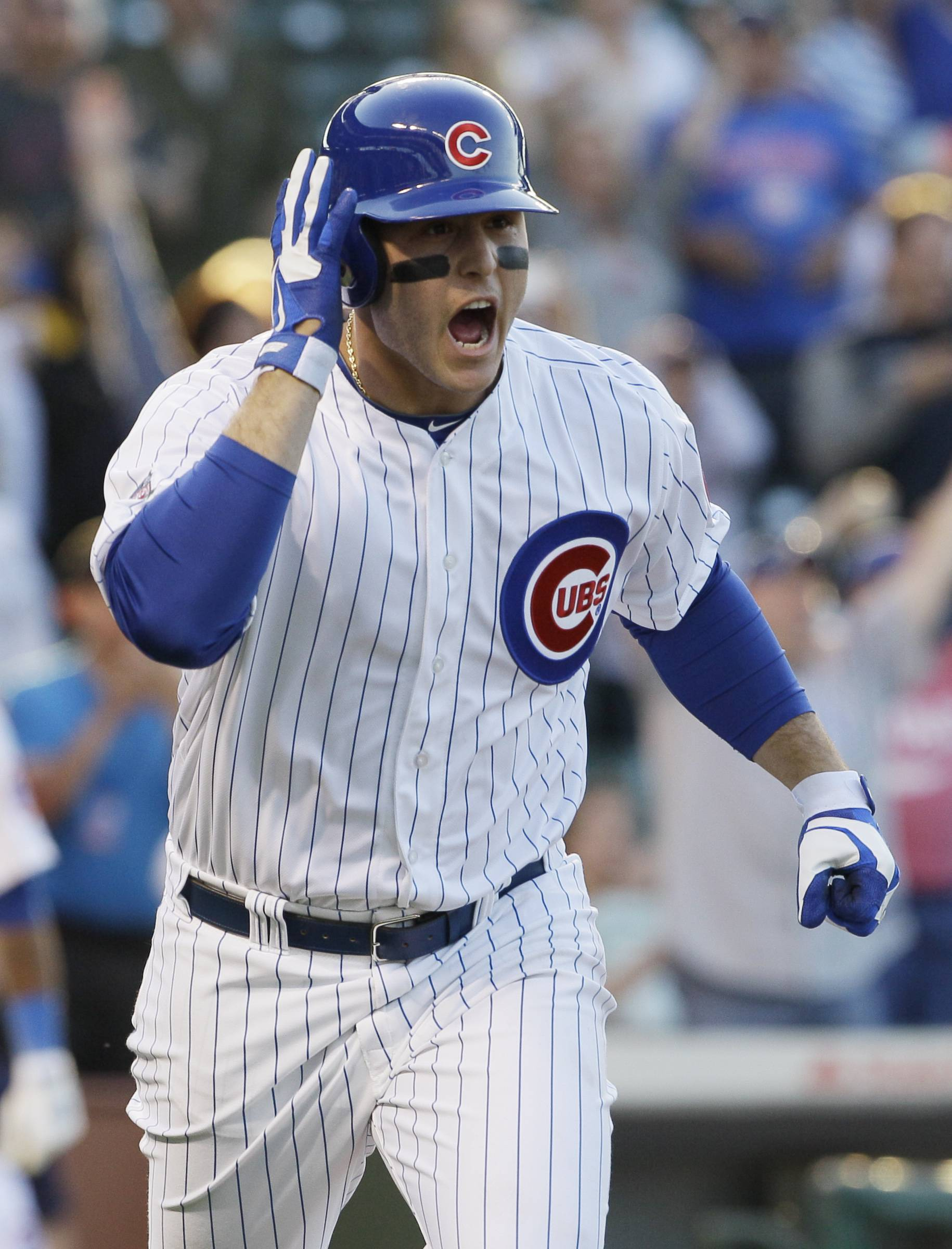 Anthony Rizzo reacts rounding the bases after hitting a walk-off 2-run homer in the 13th inning as the Cubs beat the Marlins 5-3 at Wrigley Field.