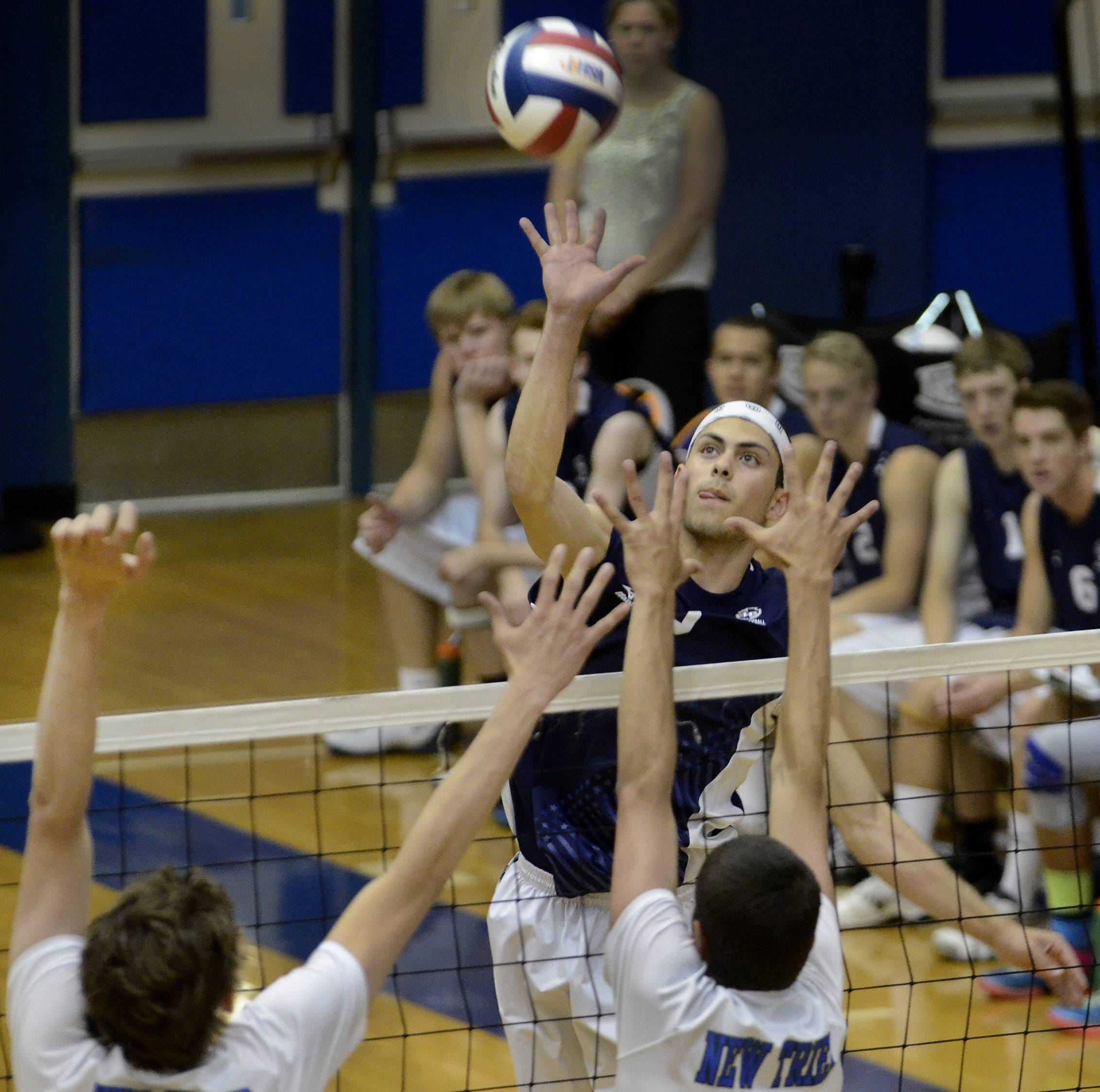 Lake Park's Dominick Terry spikes past New Trier during boys volleyball state tournament quarterfinal Friday.
