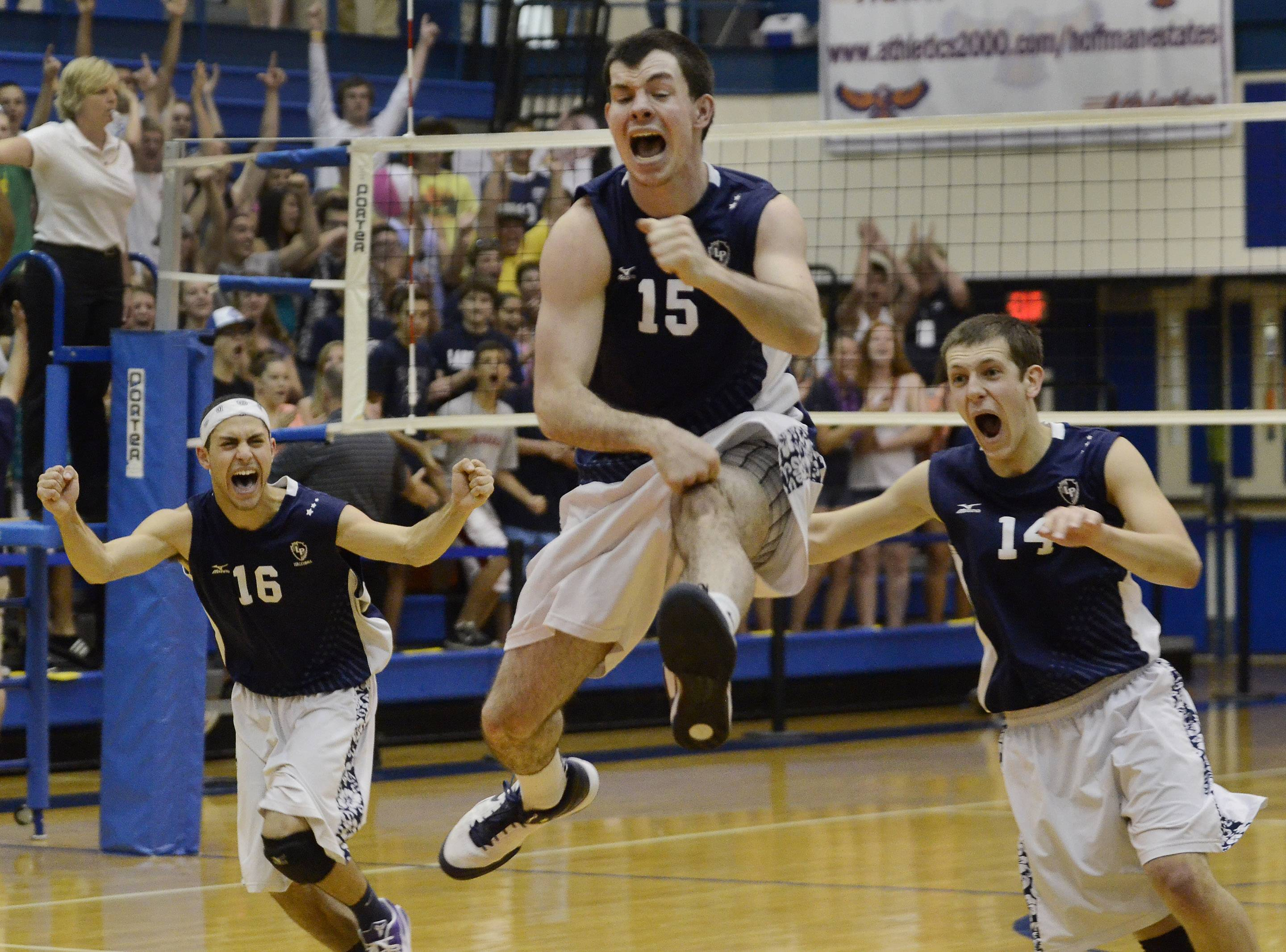 Lake Park's Sean Moore (15) celebrates with teammates Dominick Terry (16) and Jeff Yost (14) after the Lancers defeated New Trier in the boys volleyball state tournament quarterfinals Friday at Hoffman Estates.