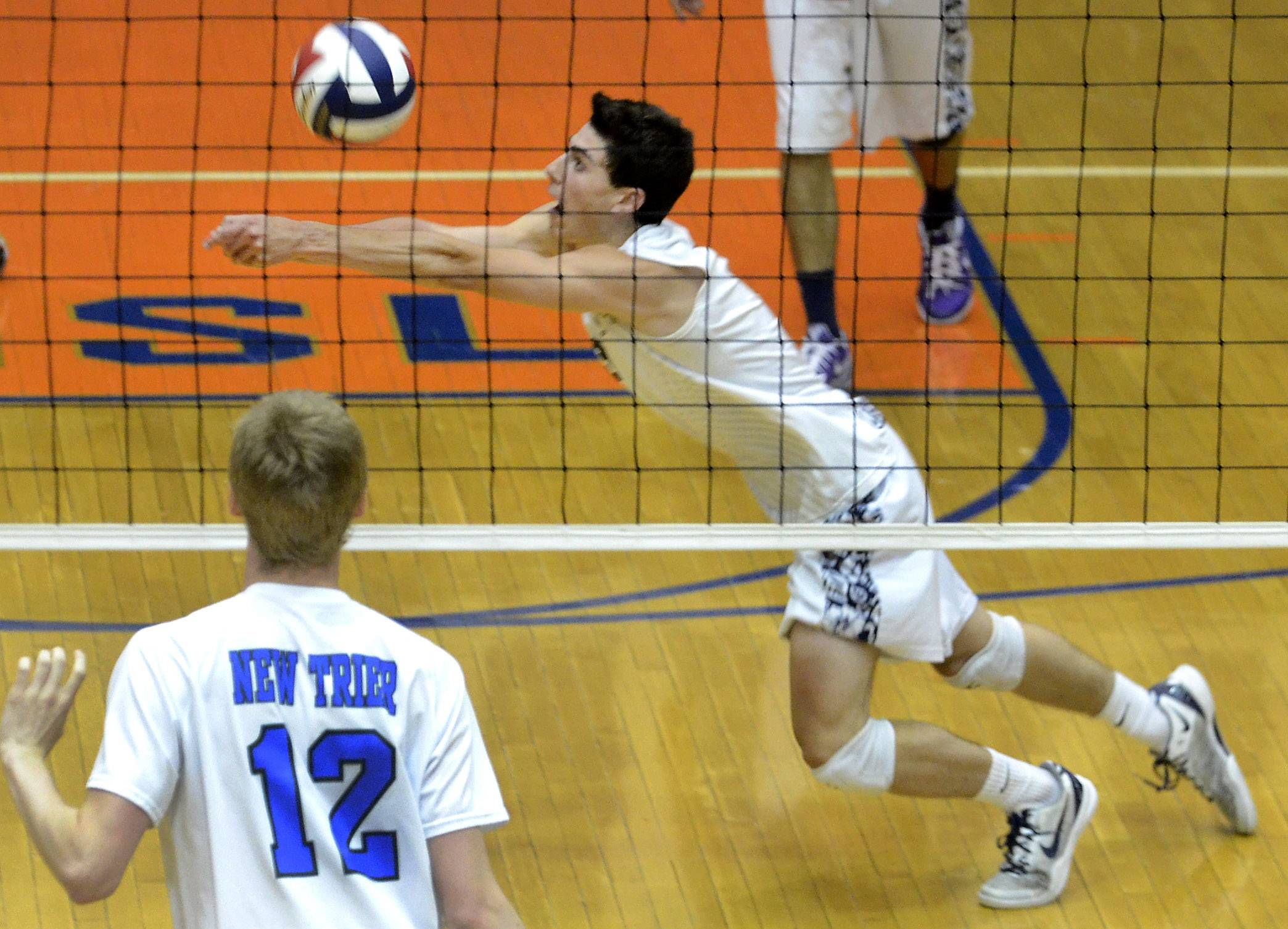 Lake Park's Anthony Amore makes a save during the boys volleyball state tournament quarterfinal against New Trier on Friday.