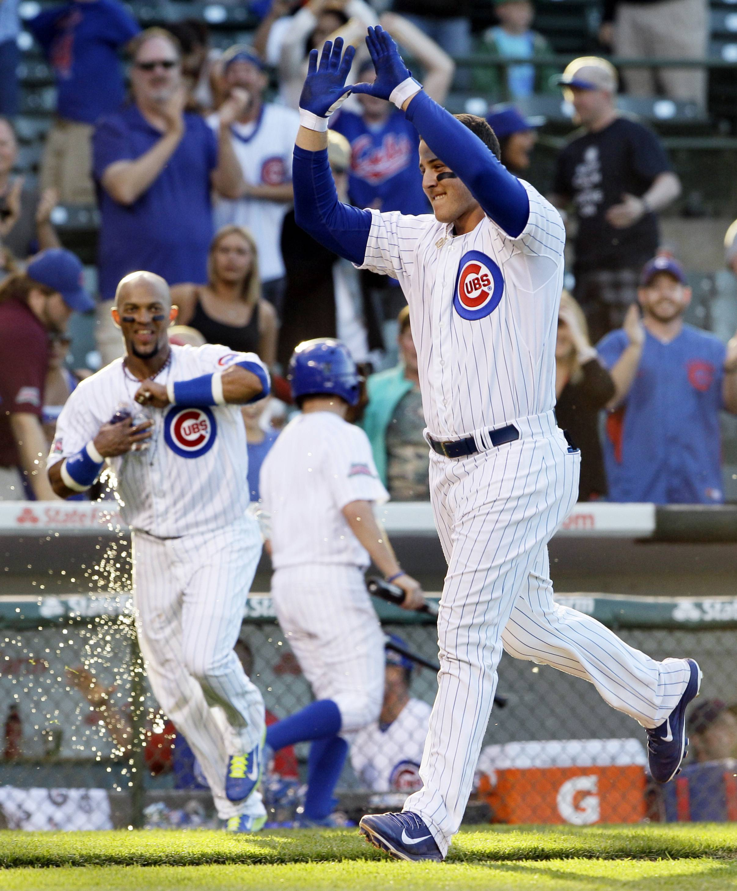 The Cubs' Anthony Rizzo celebrates as he rounds the bases after hitting the game-winning two-run home run during the 13th inning of a baseball game against the Miami Marlins in Chicago, Friday, June 6, 2014. The Cubs won 5-3.